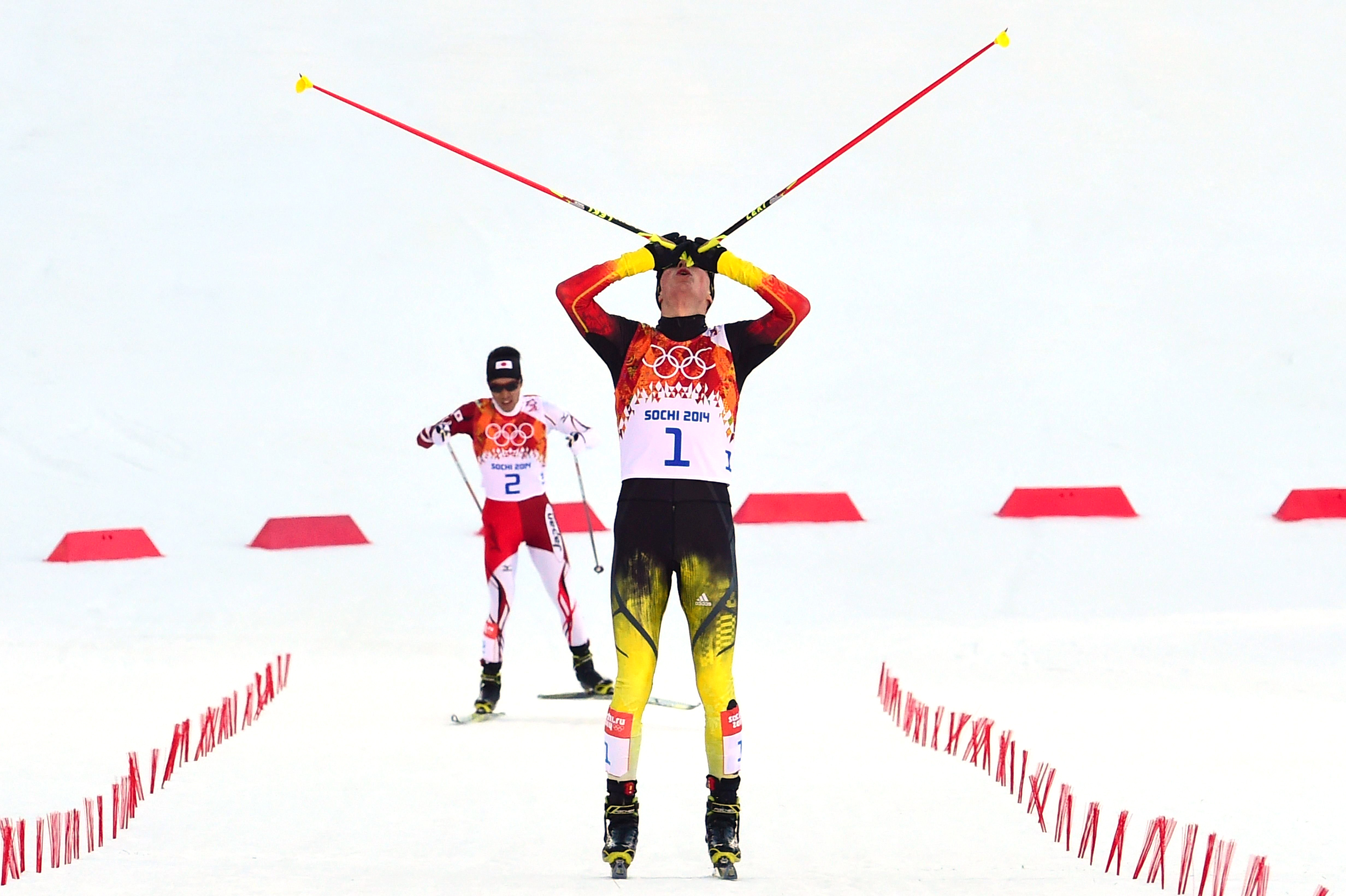 Gold medalist Eric Frenzel  of Germany celebrates at the finish line of the Nordic Combined Individual NH / 10 km Cross-Country.
