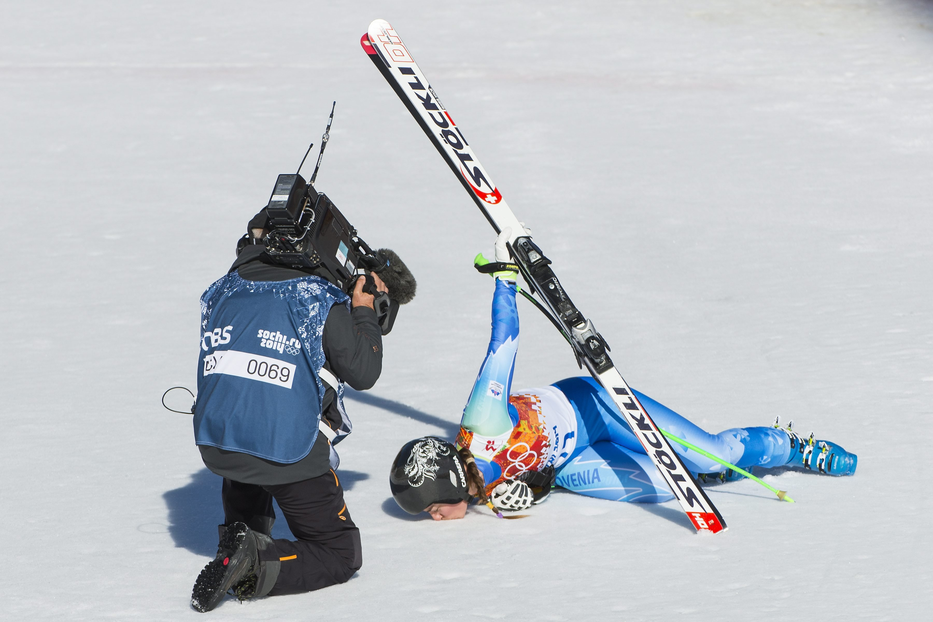 Tina Maze of Slovenia kisses the snow in the finish area during the Women's Alpine Skiing Downhill race in Rosa Khutor Alpine Center.