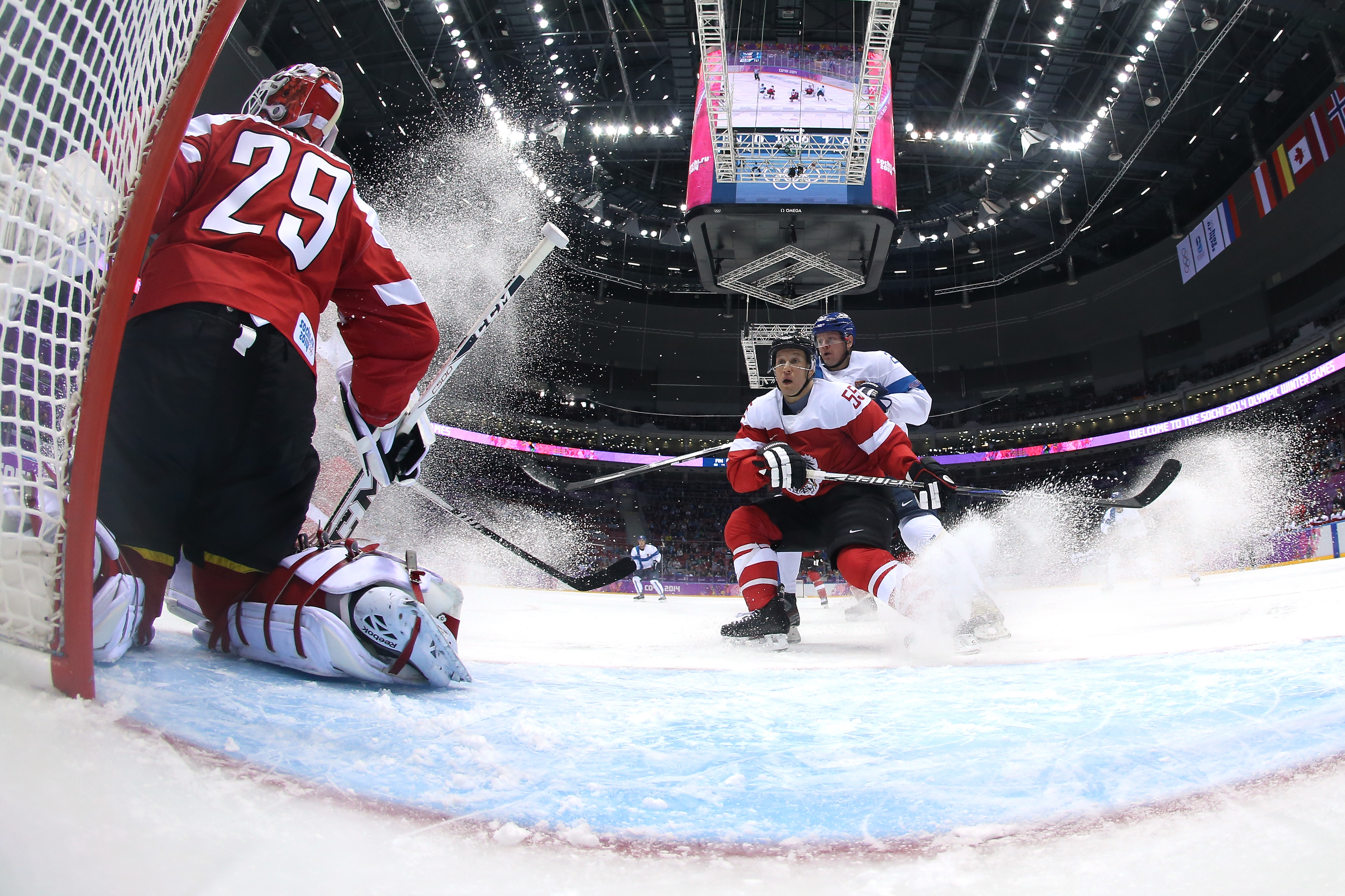Bernhard Starkbaum #29 of Austria tends goal against Finland during the Men's Ice Hockey Preliminary Round Group B game.
