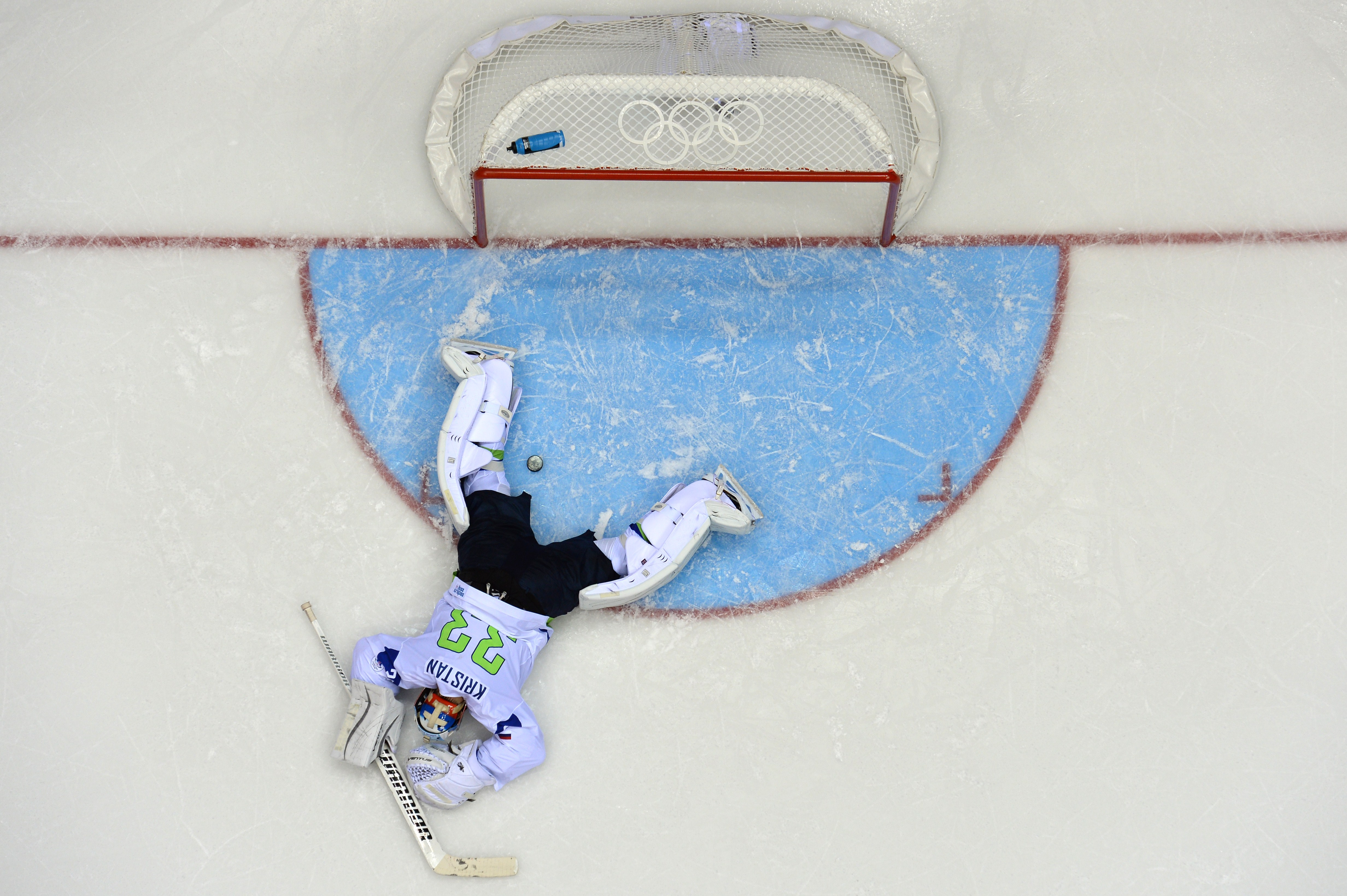 Slovenia's goalkeeper Robert Kristan reacts after Russia scored a fifth goal during the Men's Ice Hockey Group A match between Russia and Slovenia.