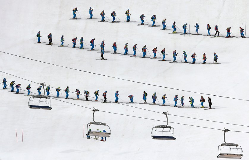 Slippers prepare the course ahead of the slalom portion of the men's supercombined.