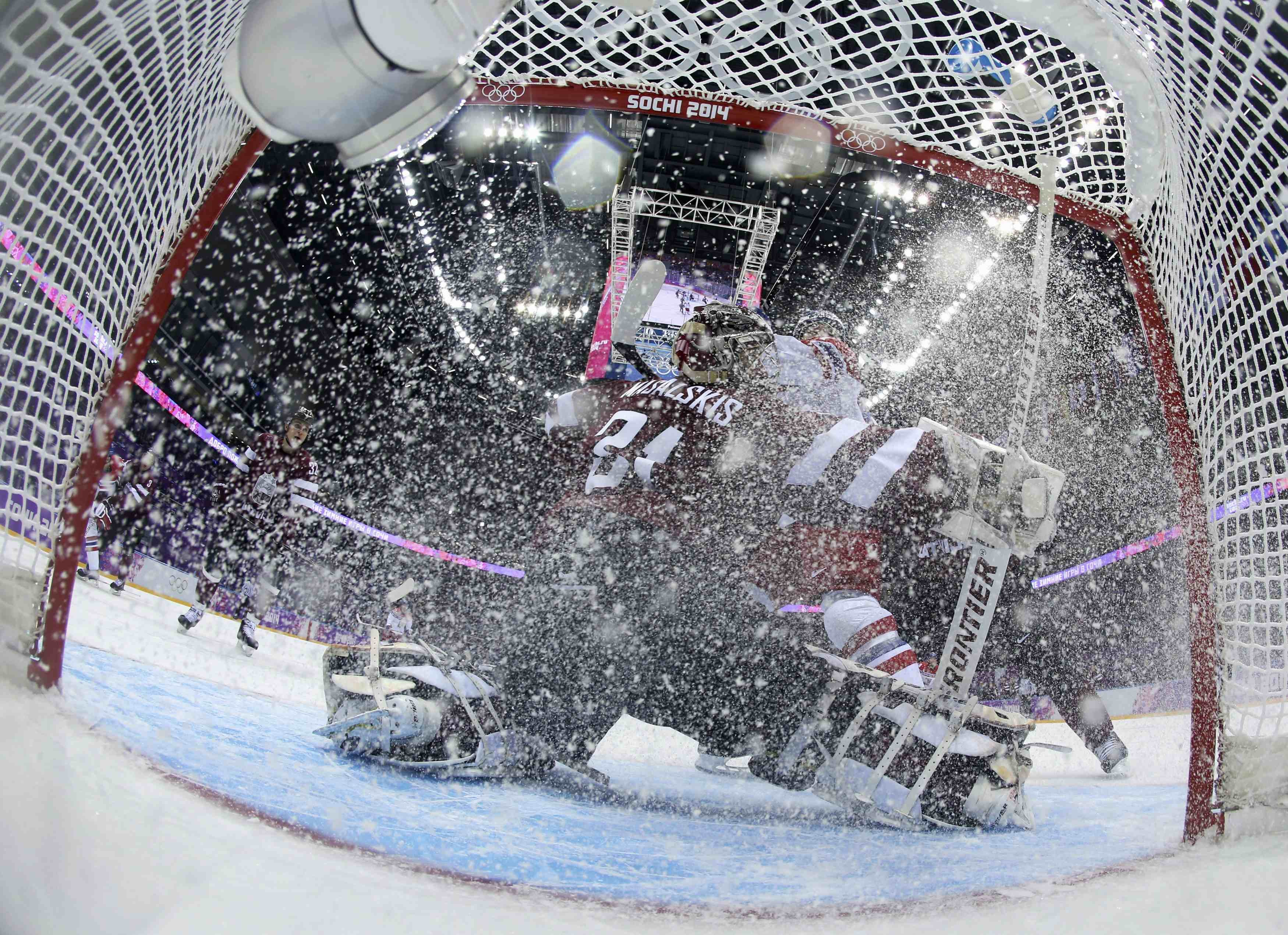Latvia's goalie Edgars Masalskis makes a save against the Czech Republic during the first period of their men's preliminary round ice hockey game.