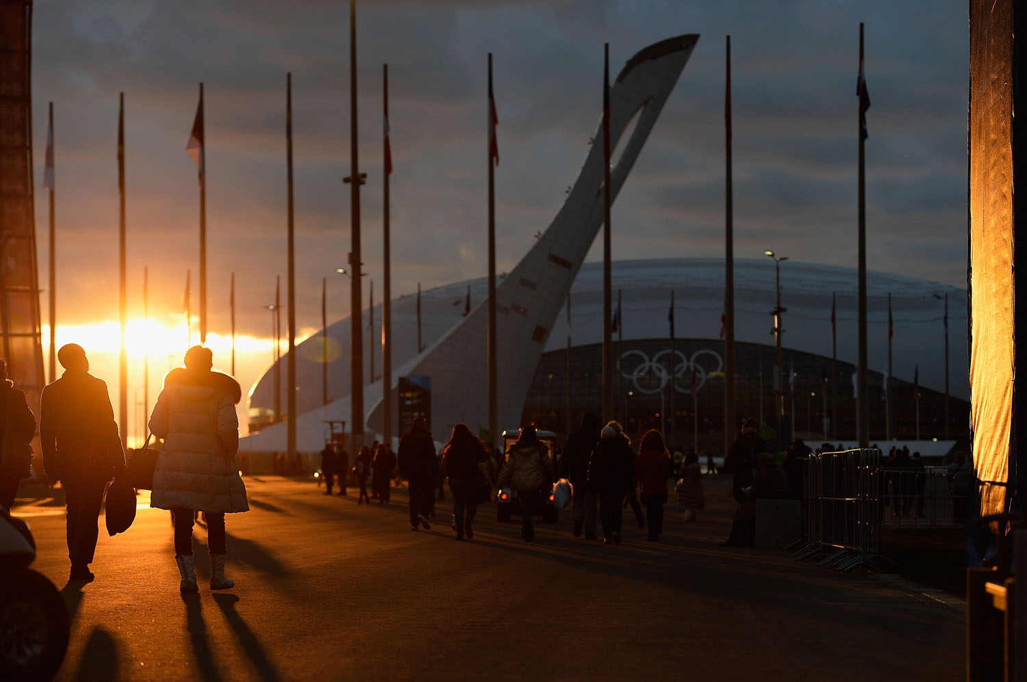 Visitors walk inside the Olympic Park prior to the Sochi 2014 Winter Olympics on February 6, 2014.