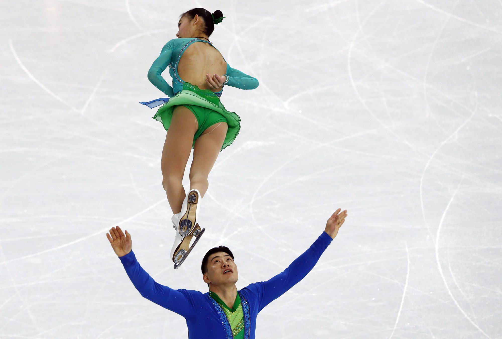 Peng Cheng and Zhang Hao of China perform in the Pairs Short Program of the Figure Skating Team event at Iceberg Skating Palace during the Sochi 2014 Olympic Games, February 6, 2014.