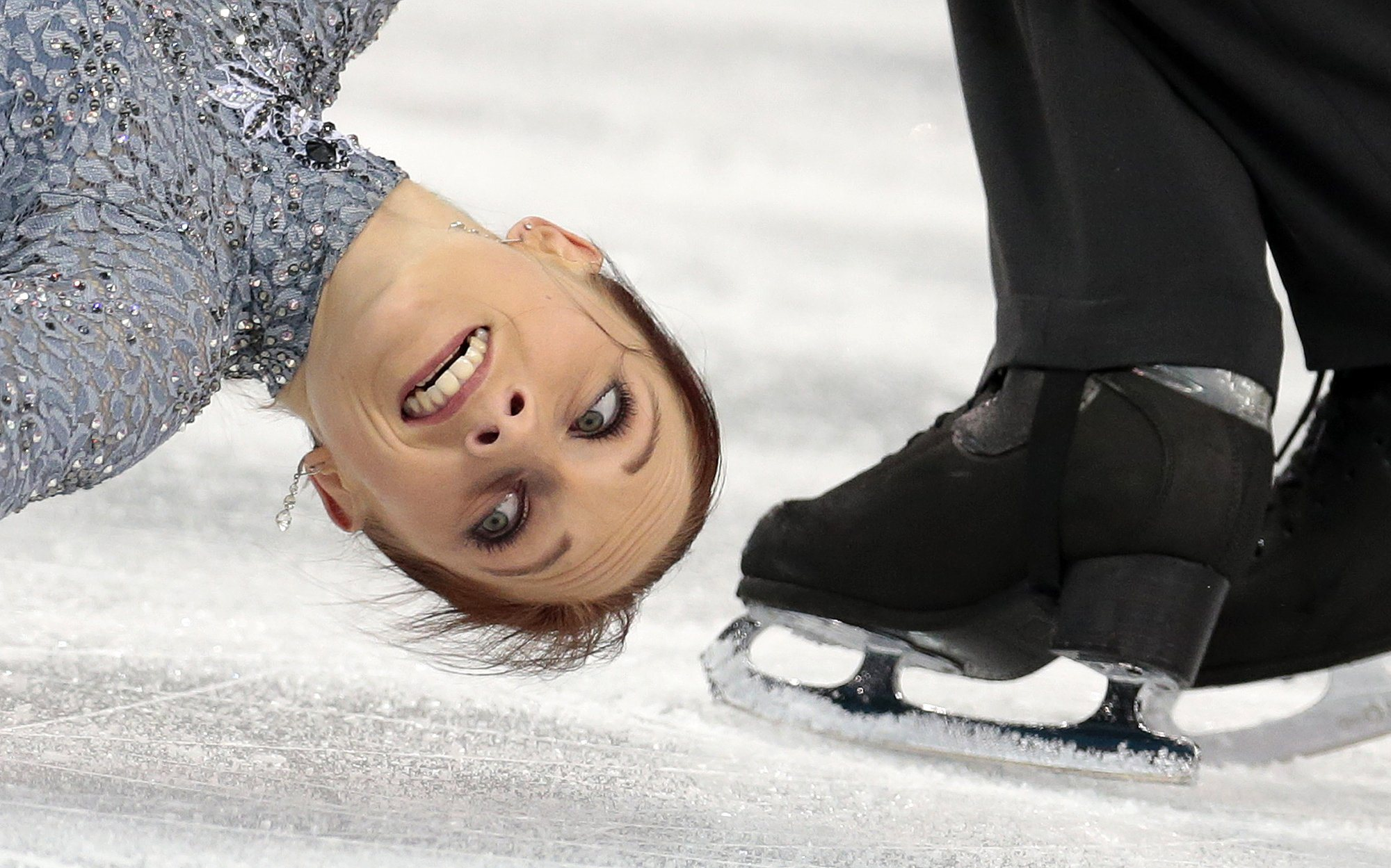 Maylin Wende and Daniel Wende of Germany compete in the team pairs short program figure skating competition at the Iceberg Skating Palace during the 2014 Winter Olympics, Feb. 6, 2014.