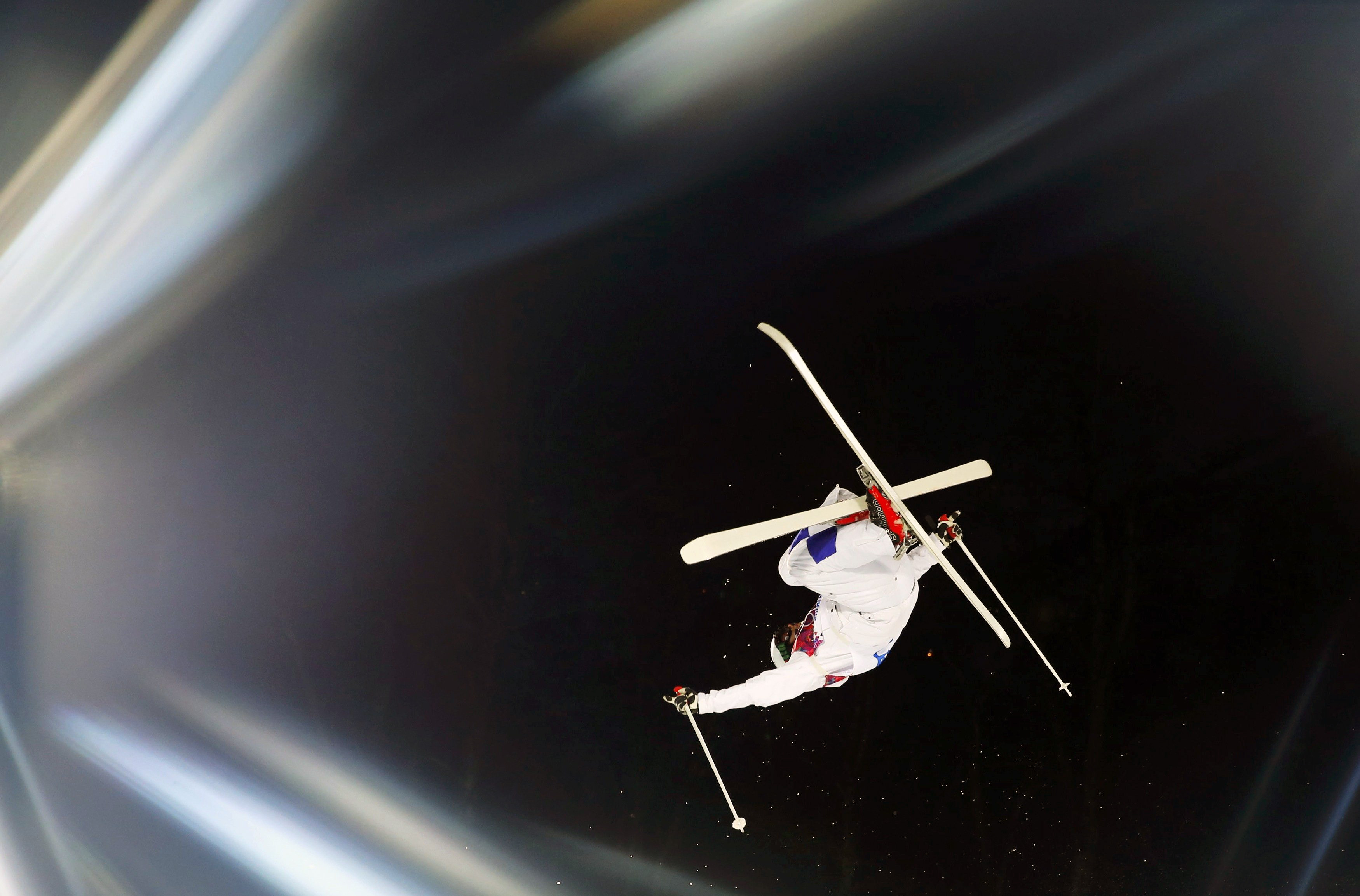 Finland's Arttu Kiramo performs a jump during the men's freestyle skiing moguls qualification round.
