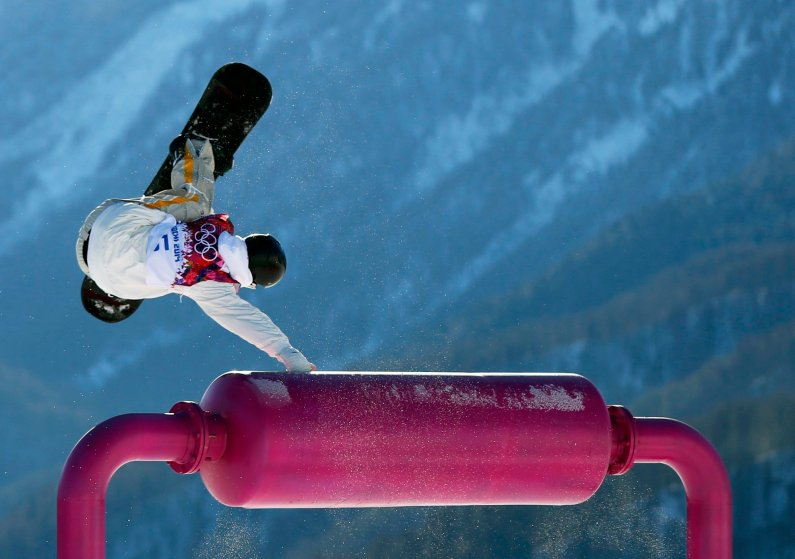 Sweden's Niklas Mattsson performs a jump during the men's slopestyle snowboarding qualifying session at the 2014 Sochi Olympic Games in Rosa Khutor, February 6, 2014.