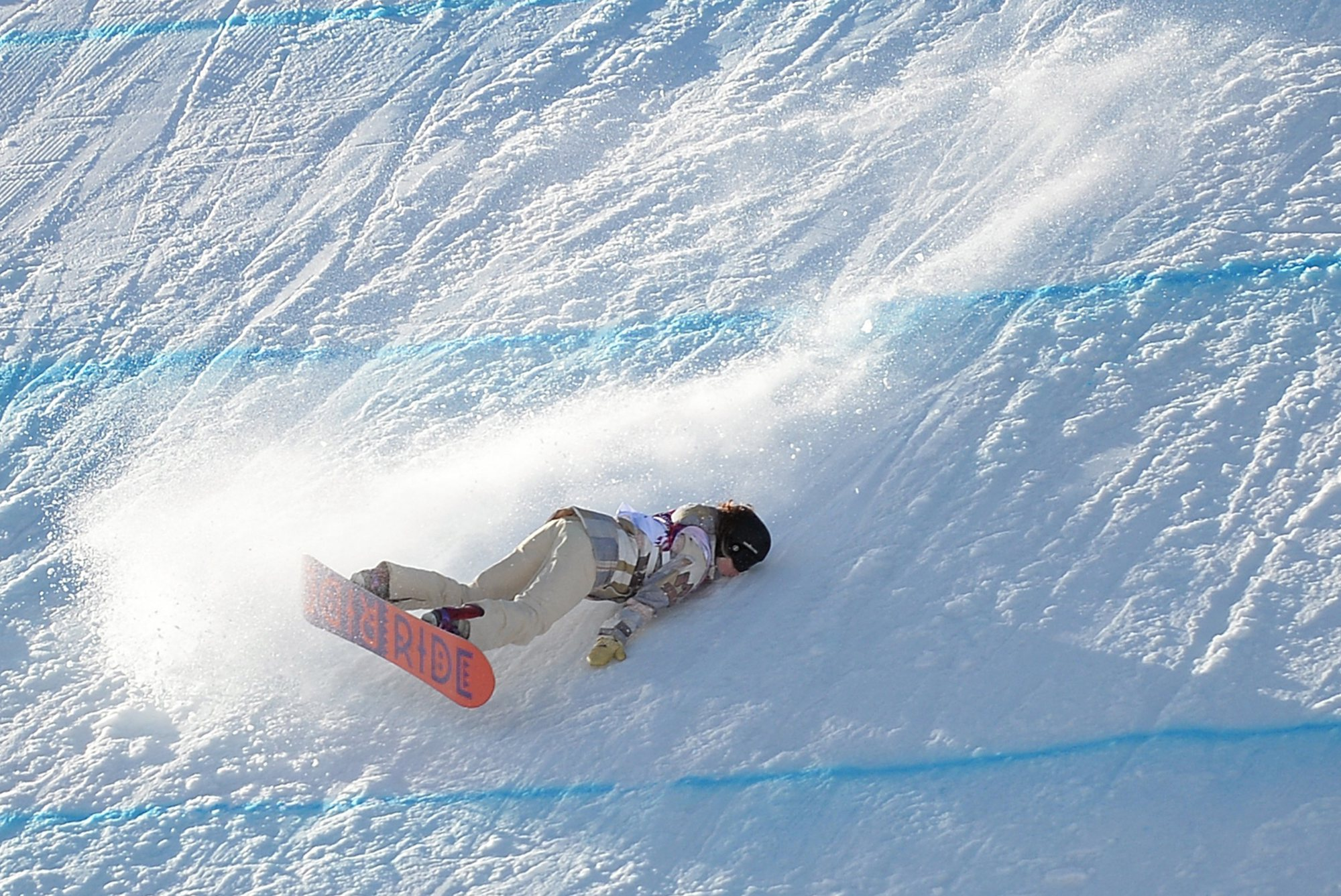 Jessika Jensen of the USA takes a fall during the ladies' snowboarding slopestyle qualifications at the Rosa Khutor Extreme Park at the Winter Olympics in Sochi, Russia, Feb. 6, 2014.