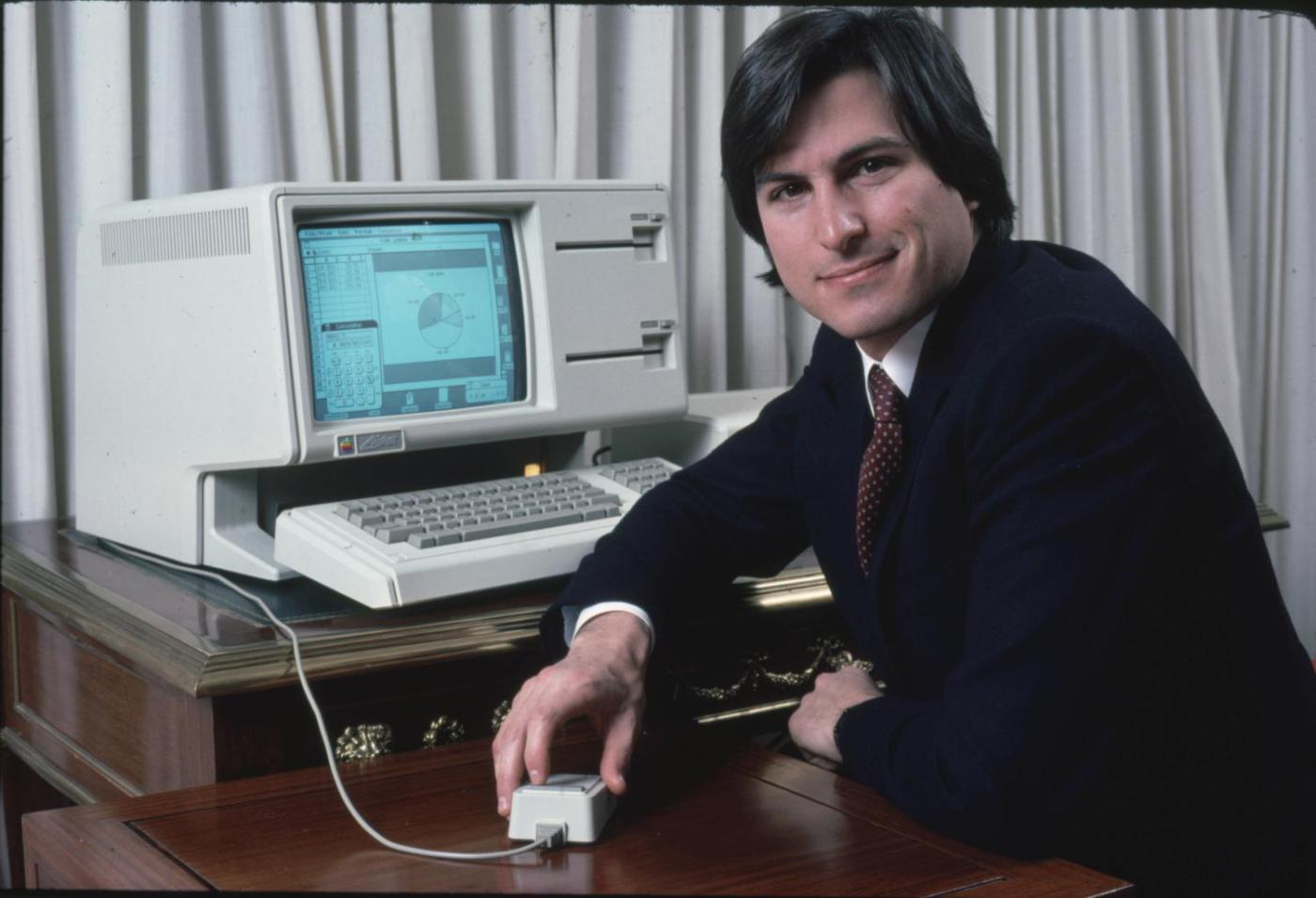 Steve Jobs poses with the Lisa computer during a 1983 press preview.