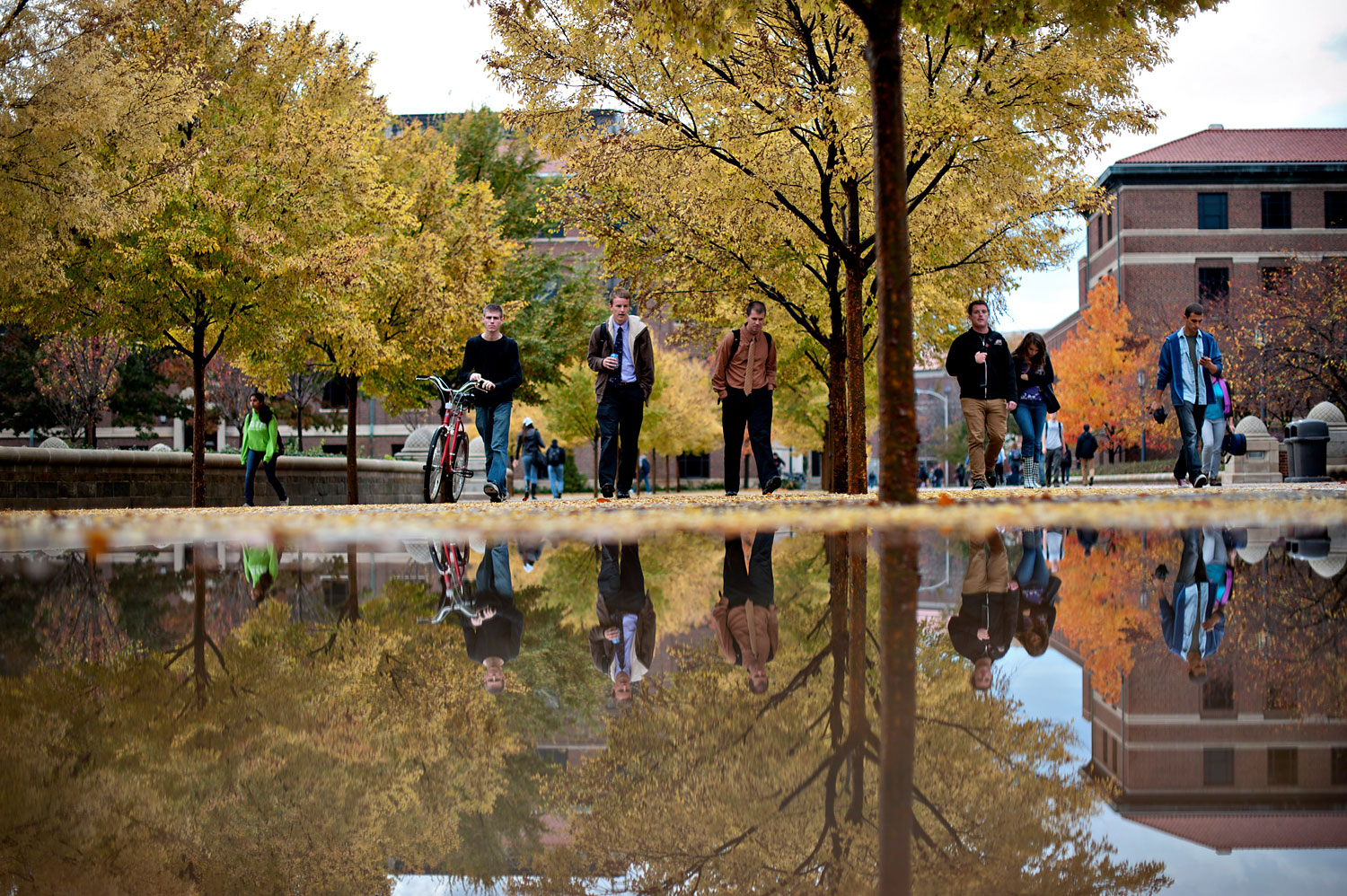 Students walk on the Purdue Mall on the campus of Purdue University in West Lafayette, Indiana, Oct. 22, 2012.
