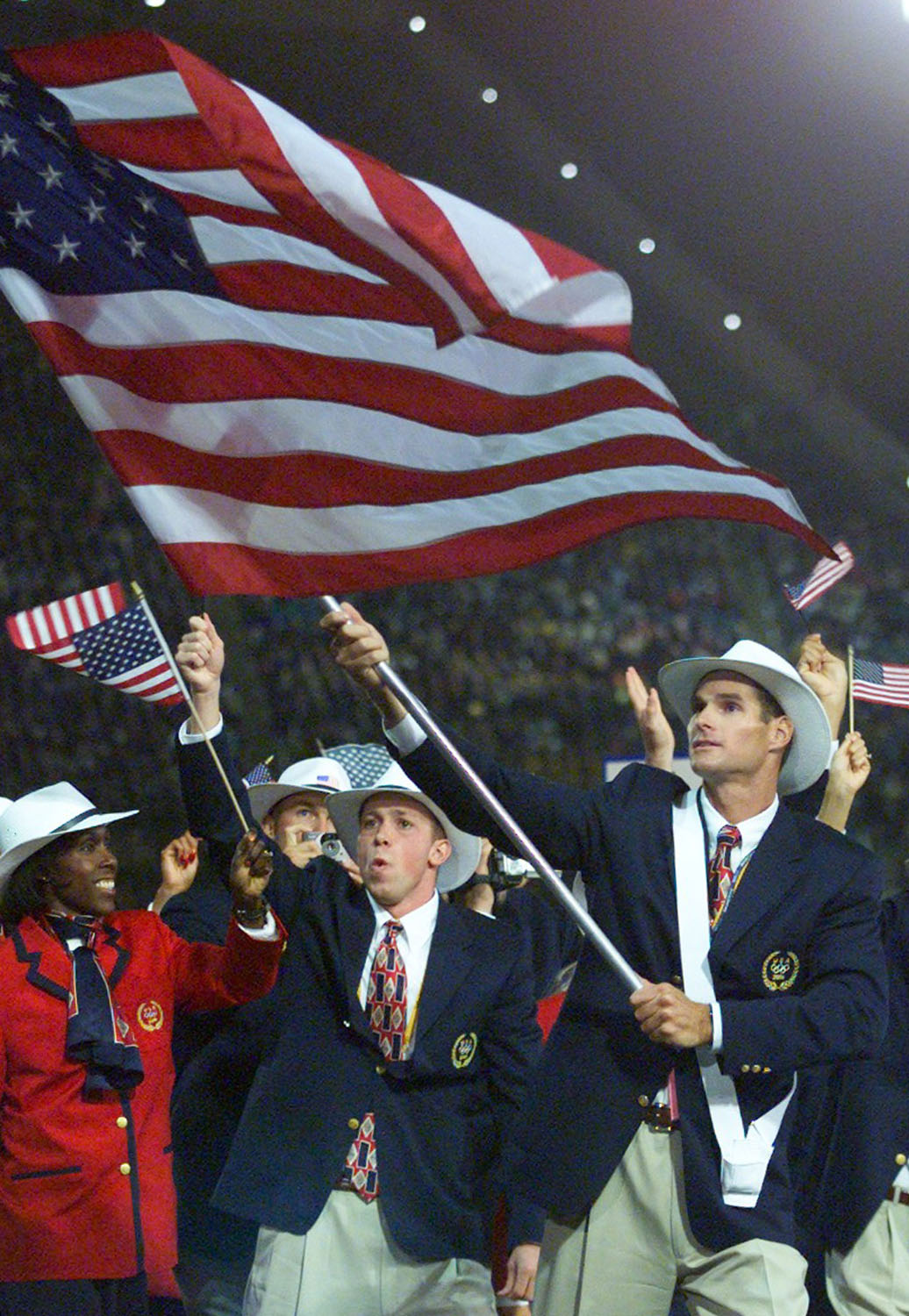 American canoeist Cliff Meidl carries his country's flag during the opening ceremony of Sydney's Olympic Games, Sept. 15, 2000.