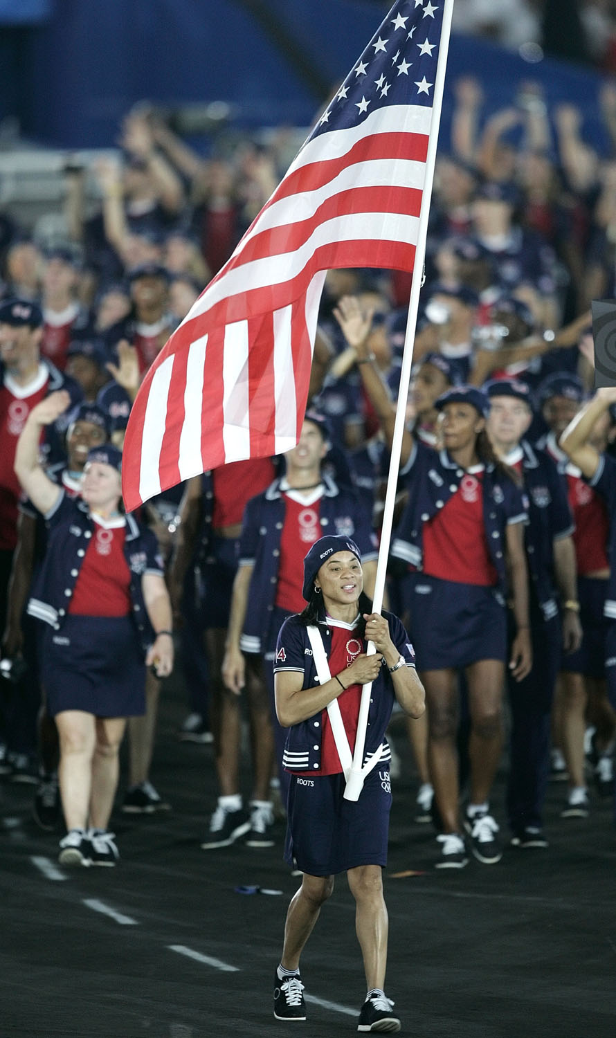 Basketball athlete Dawn Staley carries the U.S. national flag during the opening ceremony of the Athens 2004 Olympic Games.