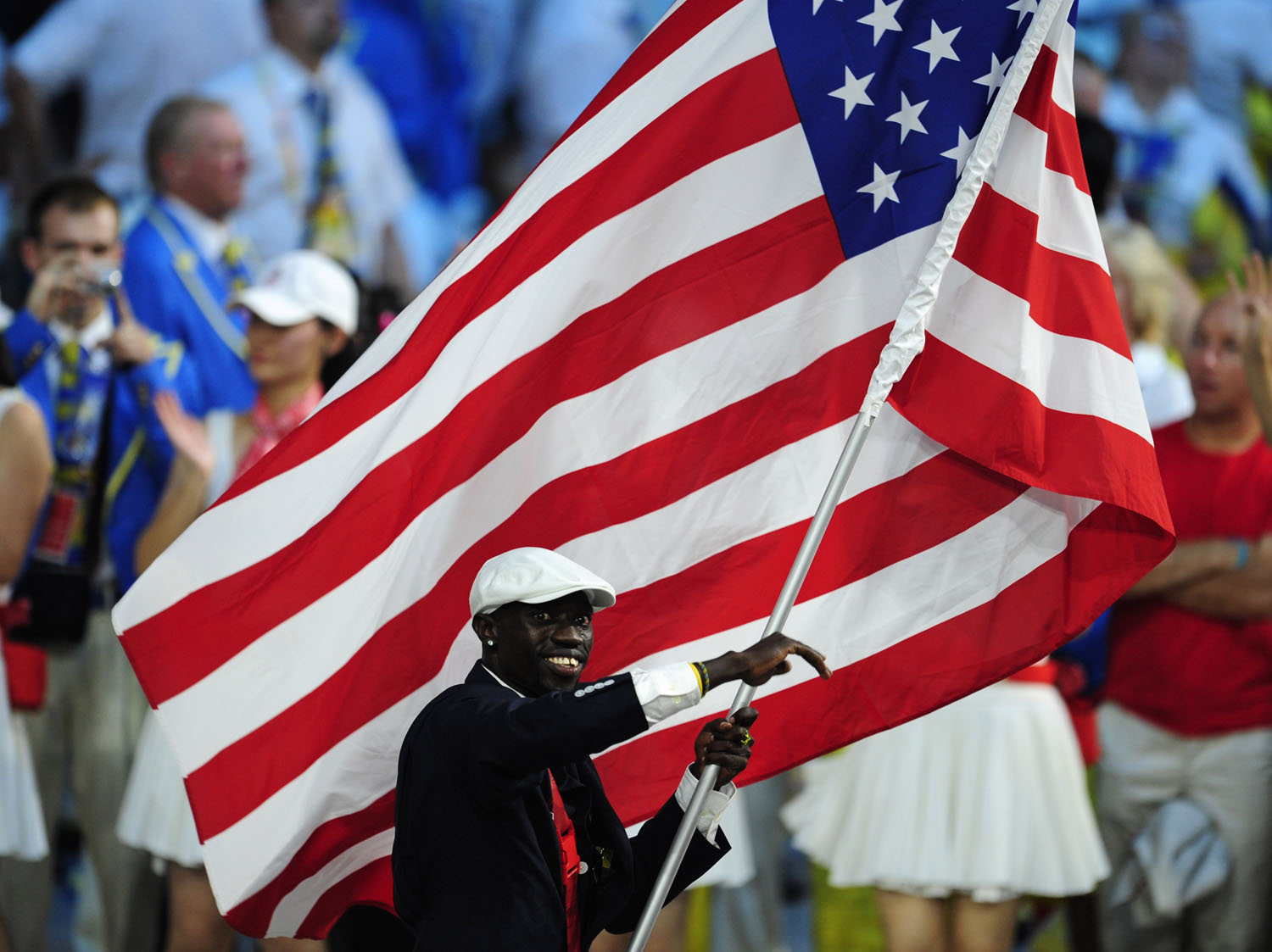 Track and Field athlete Lopez Lomong, flag-bearer of the U.S. Olympic team, marches during the opening ceremony of the Beijing 2008 Olympic Games.