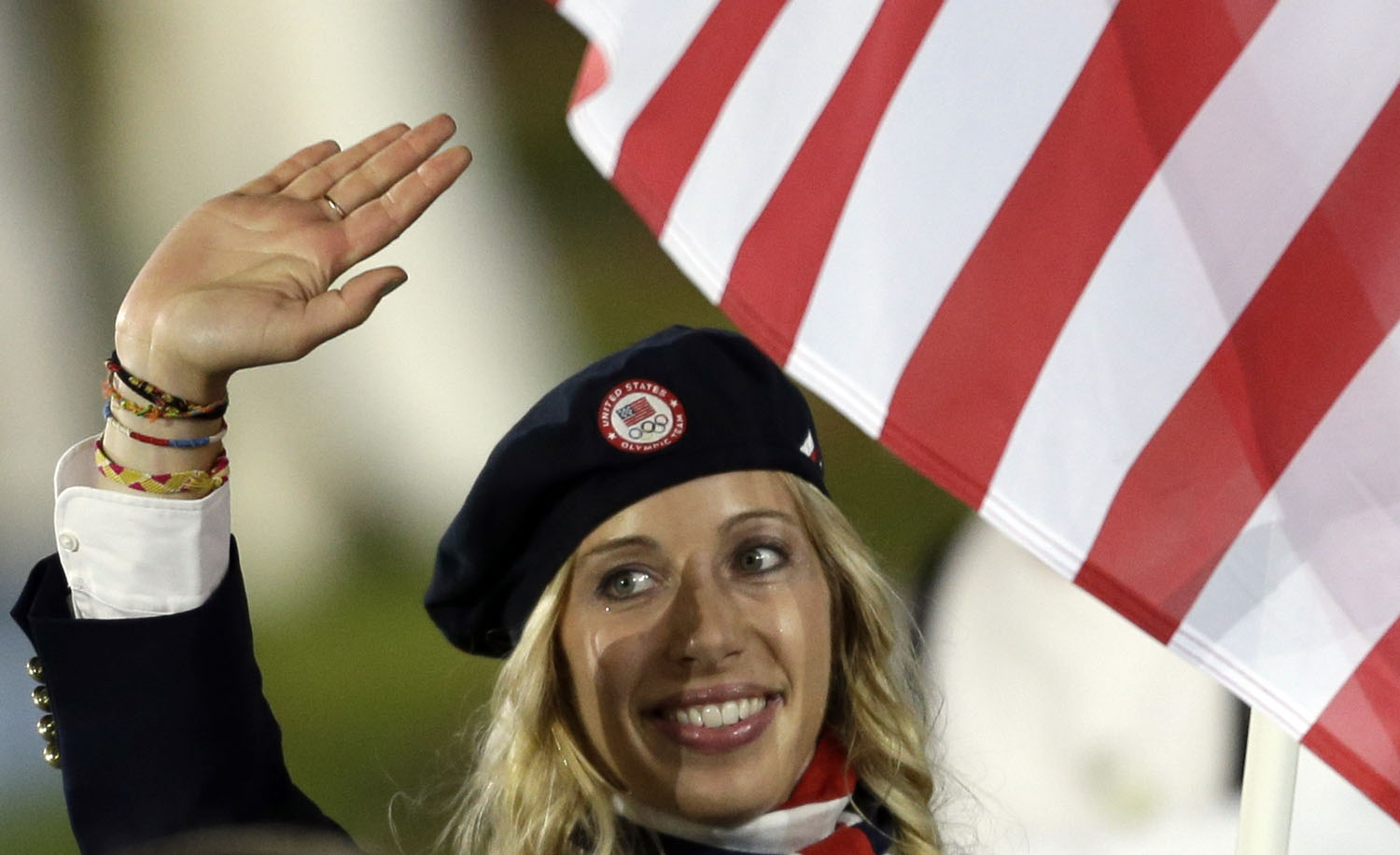 United States's fencer Mariel Zagunis carries the flag during the Opening Ceremony at the 2012 Summer Olympics, Friday, July 27, 2012, in London.