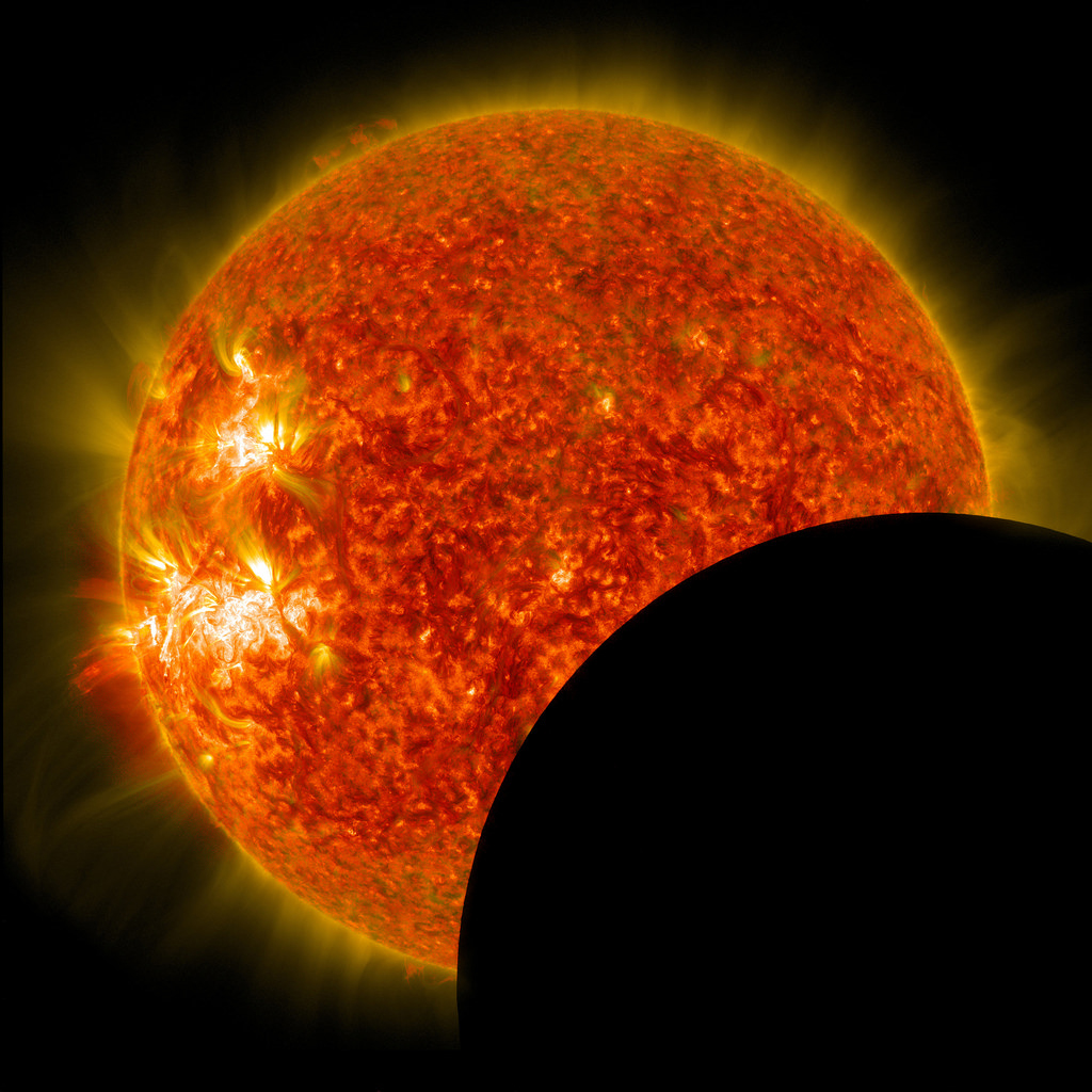 NASA's Solar Dynamics Observatory captured this image of the moon crossing in front of ithe sun on Jan. 30, 2014, at 10:30 a.m. EST.