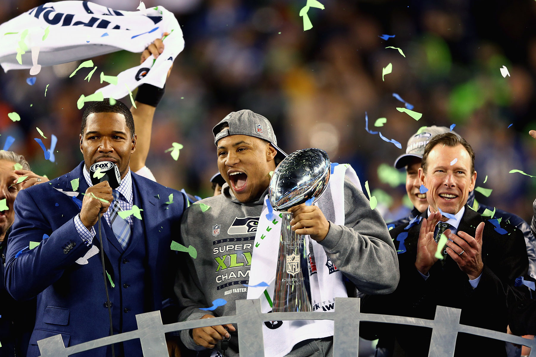 Outside linebacker and Super Bowl MVP Malcolm Smith of the Seattle Seahawks holds the Vince Lombardi Trophy after winning Super Bowl XLVIII.
