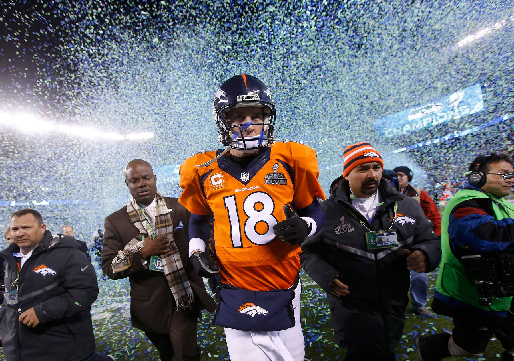 Denver Broncos quarterback Peyton Manning runs off the field after being defeated by the Seattle Seahawks in the NFL Super Bowl XLVIII.