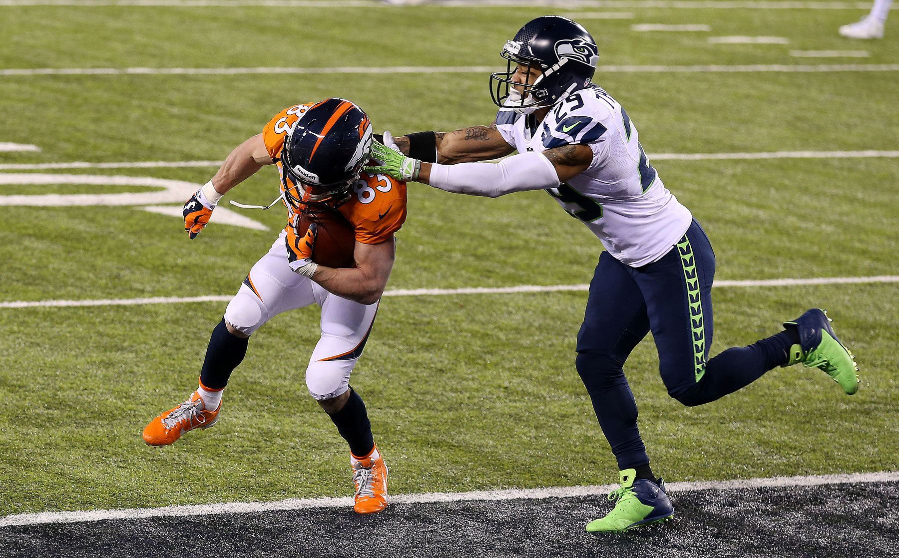 Wide receiver Wes Welker of the Denver Broncos scores the two point conversion after touchdown by wide receiver Demaryius Thomas during the third quarter.