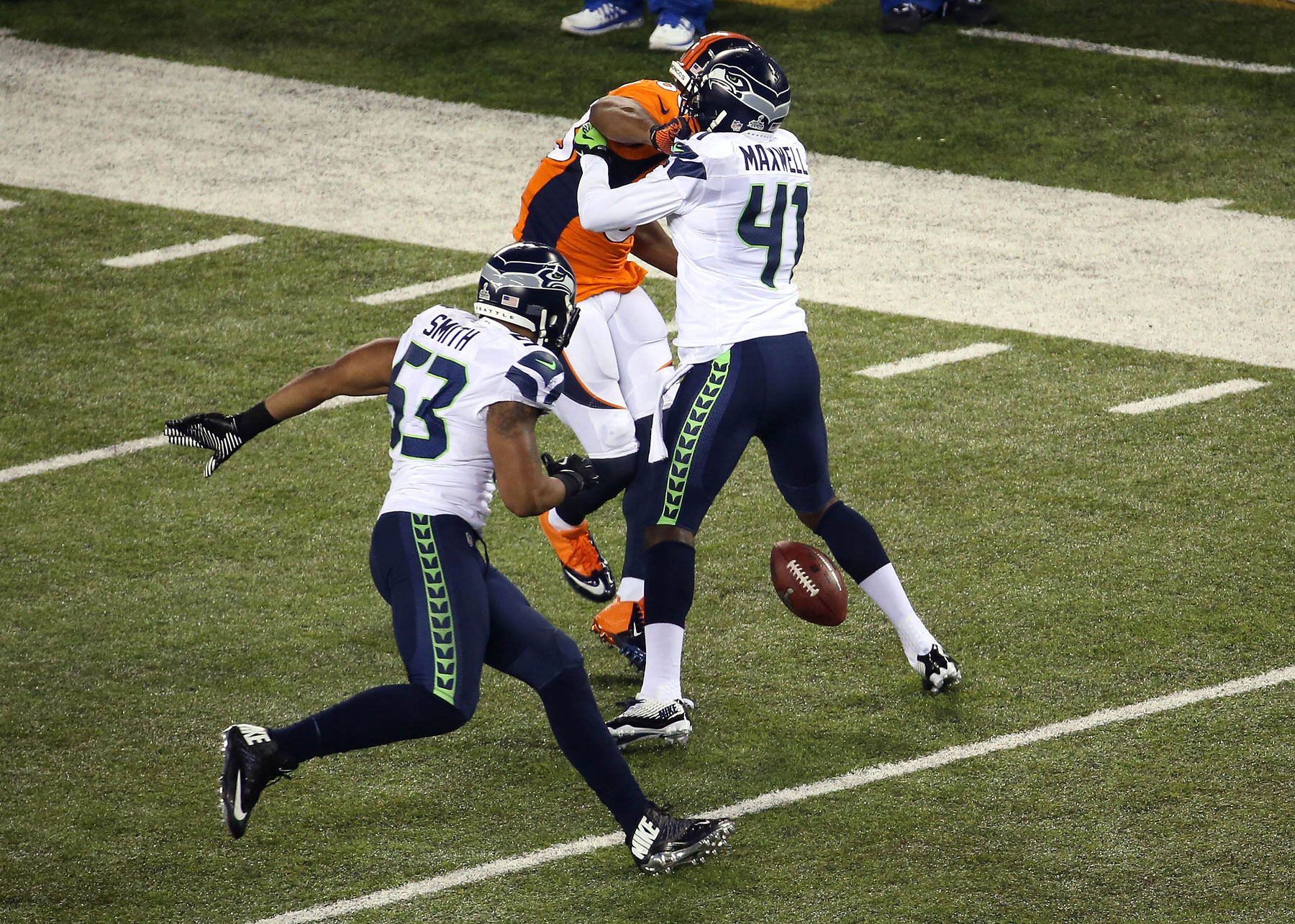 Seattle Seahawks cornerback Byron Maxwell forces the fumble of Denver Broncos wide receiver Demaryius Thomas during the third quarter.