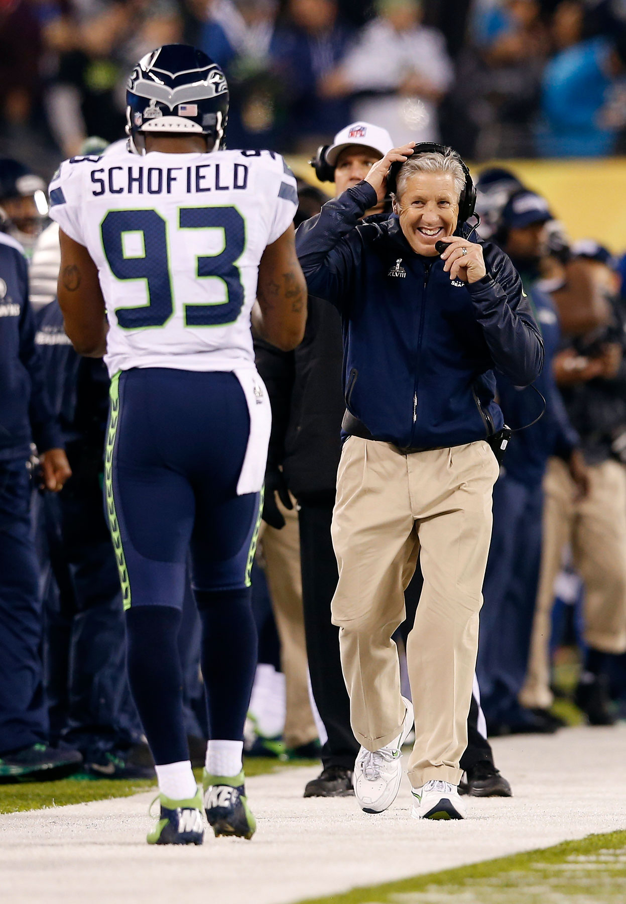 Seattle Seahawks head coach Pete Carroll, right, reacts on the sidelines with O'Brien Schofield during the second half.