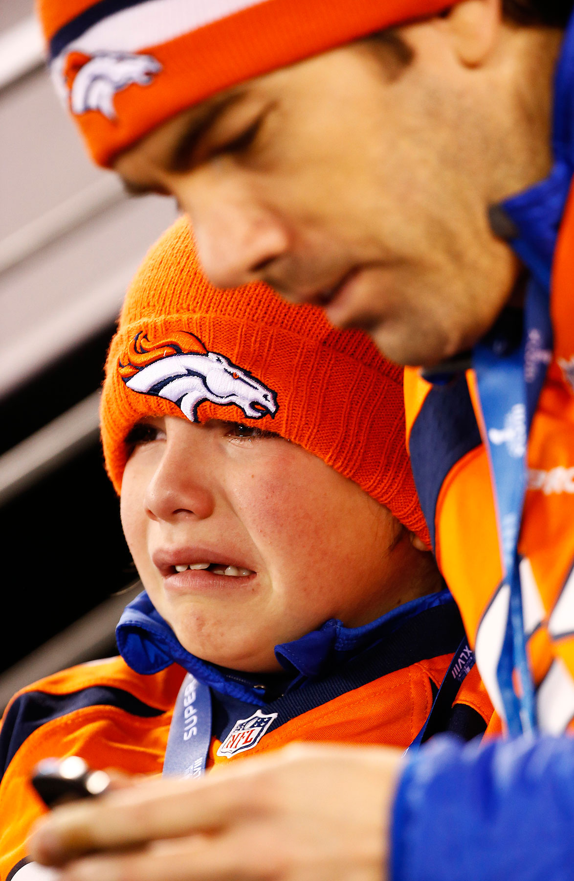 A young Denver fan cries during the second quarter of Super Bowl XLVIII.