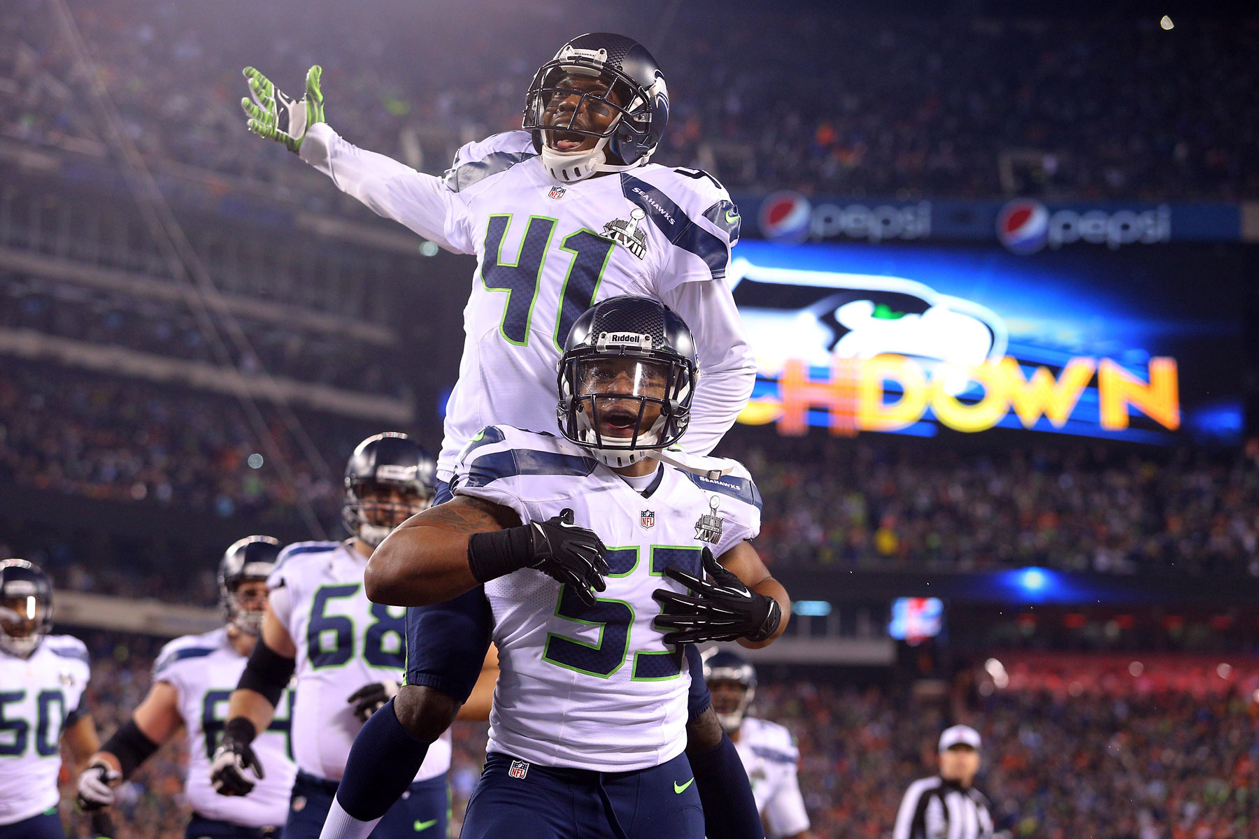 Seattle Seahawks outside linebacker Malcolm Smith and cornerback Byron Maxwell celebrate a touchdown during the second quarter.
