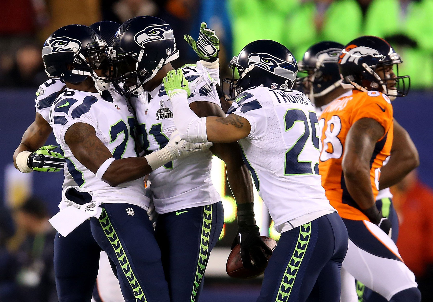 Strong safety Kam Chancellor of the Seattle Seahawks celebrates his interception with teammates against the Denver Broncos in the first quarter.
