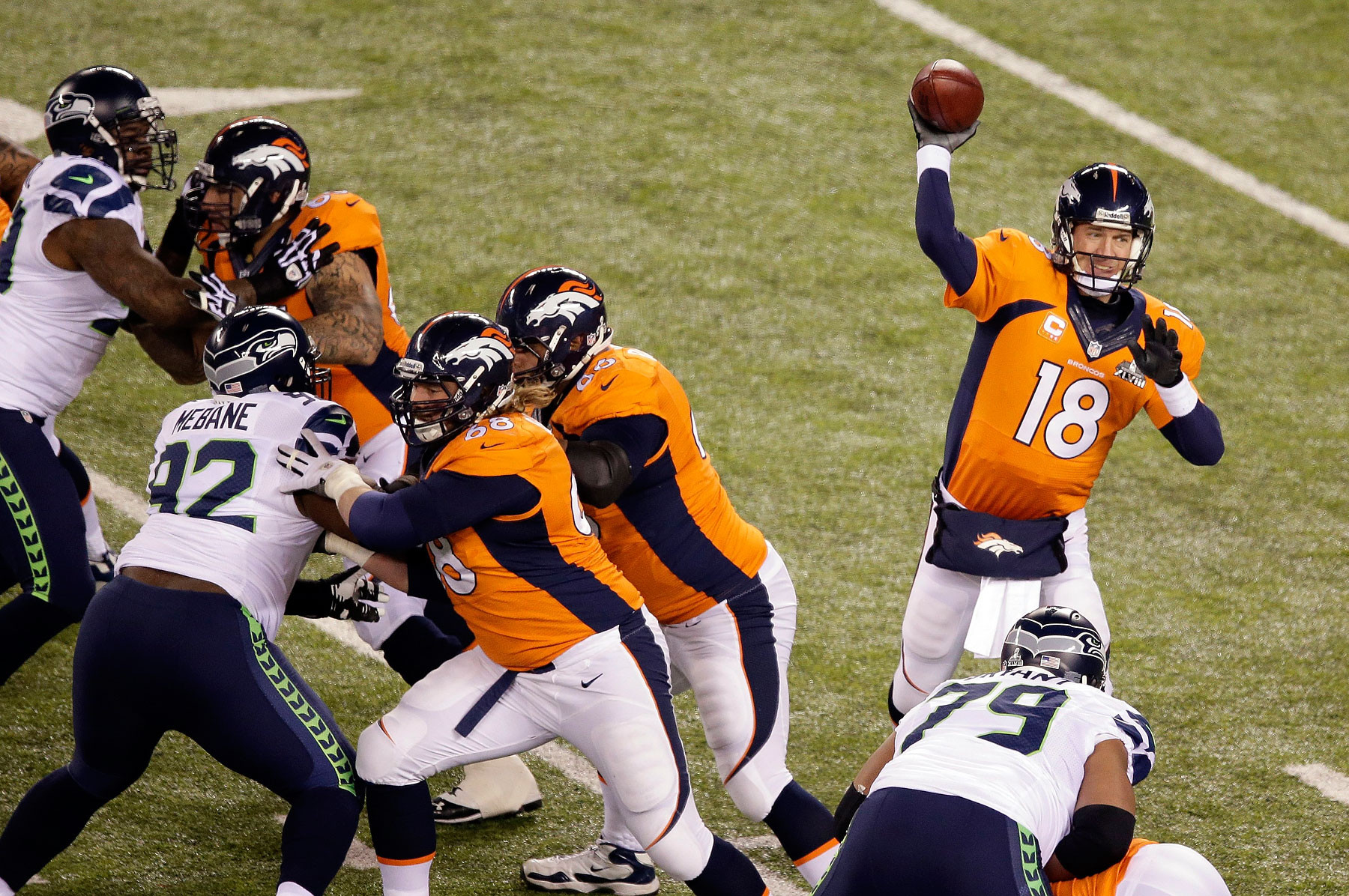 Denver Broncos' Peyton Manning throws a pass during the first half.