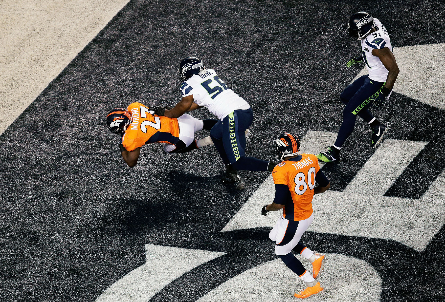Running back Knowshon Moreno of the Denver Broncos recovers the ball in the endzone for a safety against the Seattle Seahawks during the first quarter.