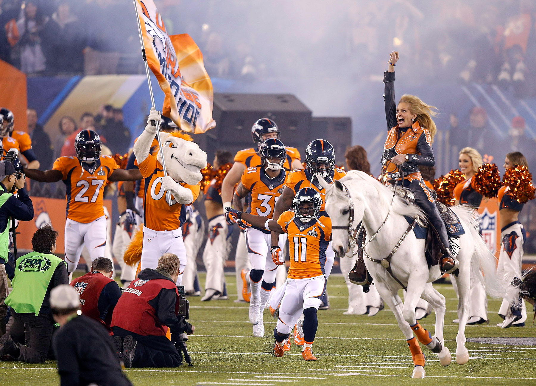 Thunder leads the Denver Broncos players onto the field before the NFL Super Bowl XLVIII.