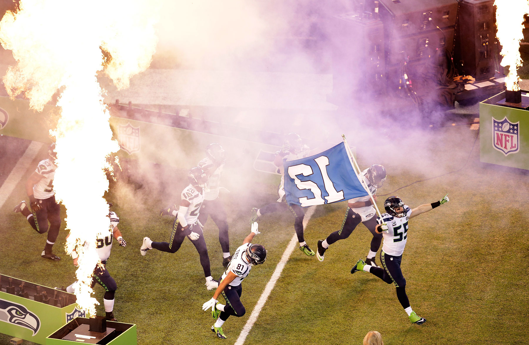 Linebacker Heath Farwell of the Seattle Seahawks leads the team onto the field at start of Super Bowl XLVIII .