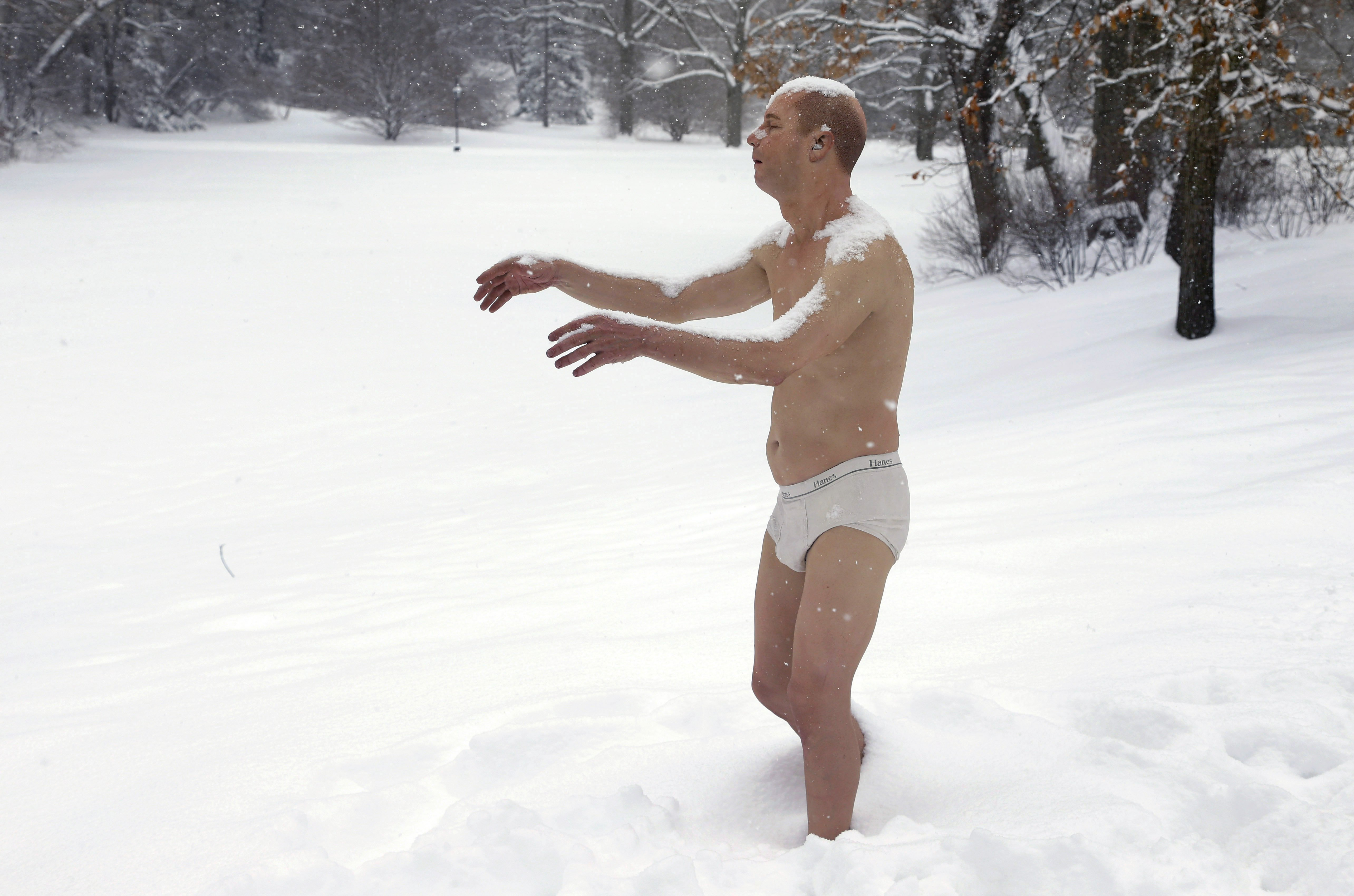 A statue of a man sleepwalking in his underpants is surrounded by snow on the campus of Wellesley College, in Wellesley, Mass., Feb. 5, 2014. The sculpture entitled  Sleepwalker  is part of an exhibit by sculptor Tony Matelli at the college's Davis Museum.