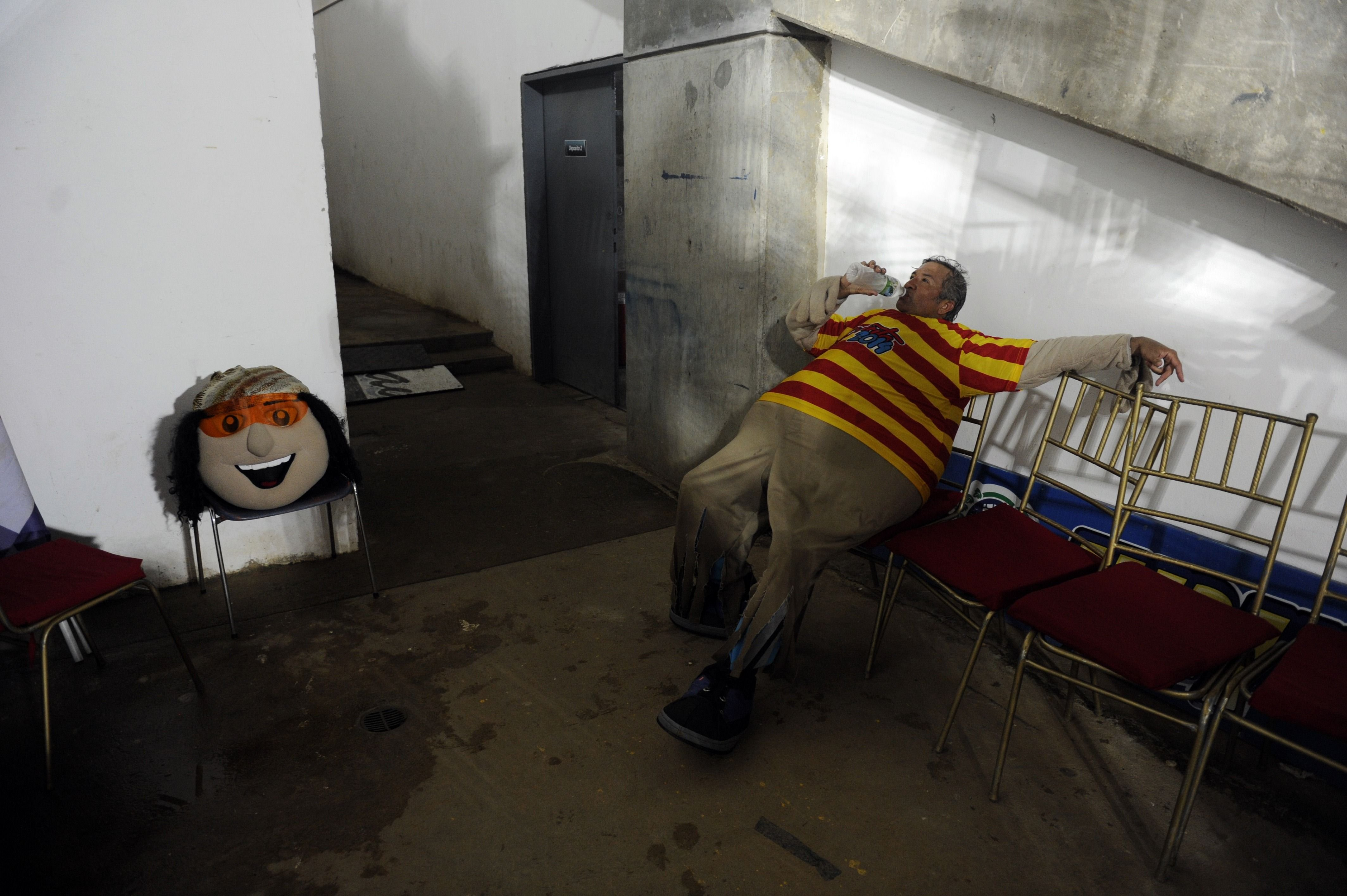 The man that works as the mascot  Margarito  for the 2014 Caribbean baseball series rests backstage during the game between Dominican Republic's Tigres de Licey  and Venezuela's Navegantes del Magallanes, on Feb. 4, 2014, in Porlamar City, Margarita Island, Nueva Esparta state, Venezuela.