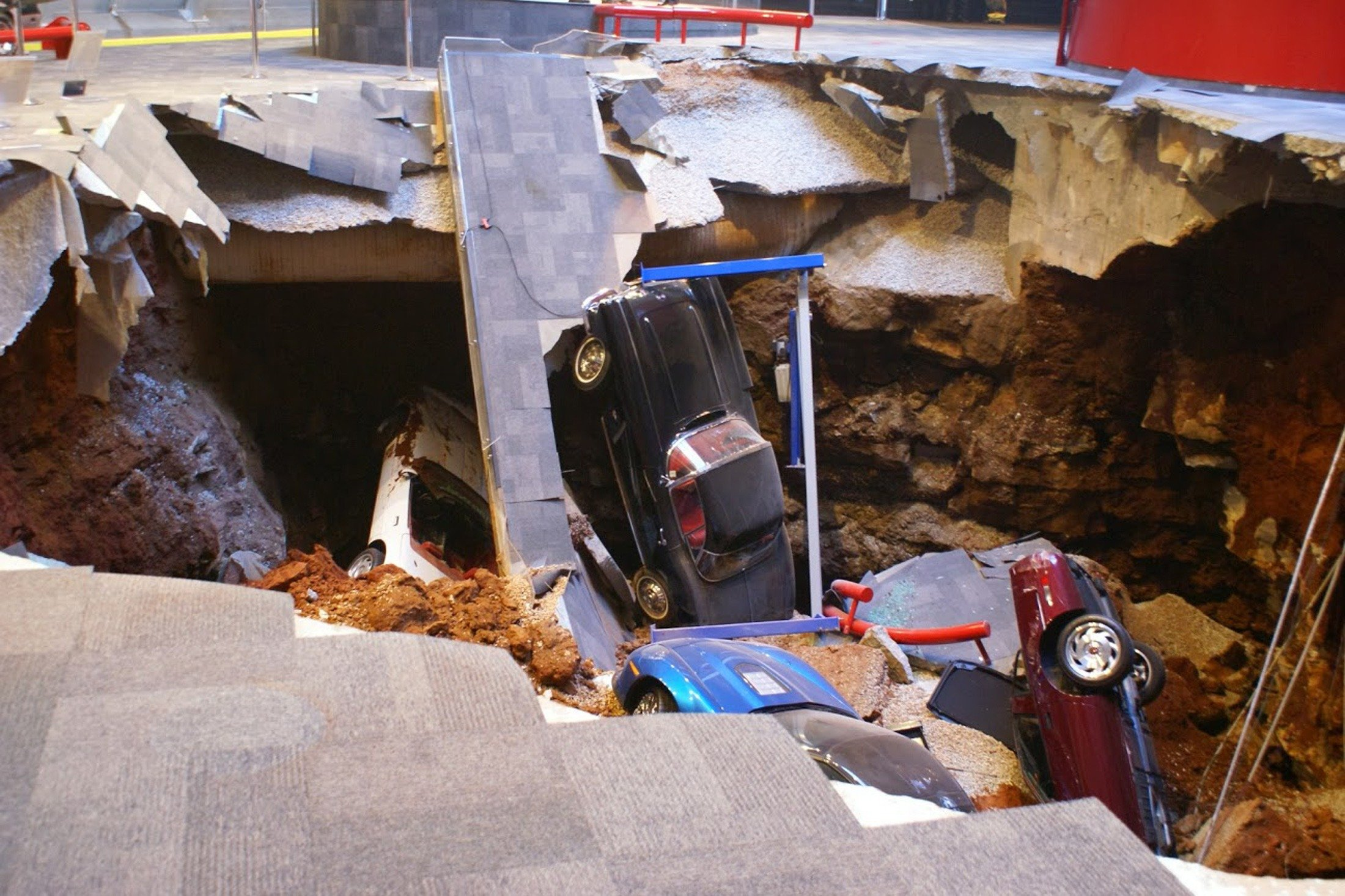 A 40-foot sinkhole opened up under the National Corvette Museum Feb. 12, 2014 and swallowed eight Corvettes, including the historic 1992 White 1 Millionth Corvette, in Bowling Green, Ky.