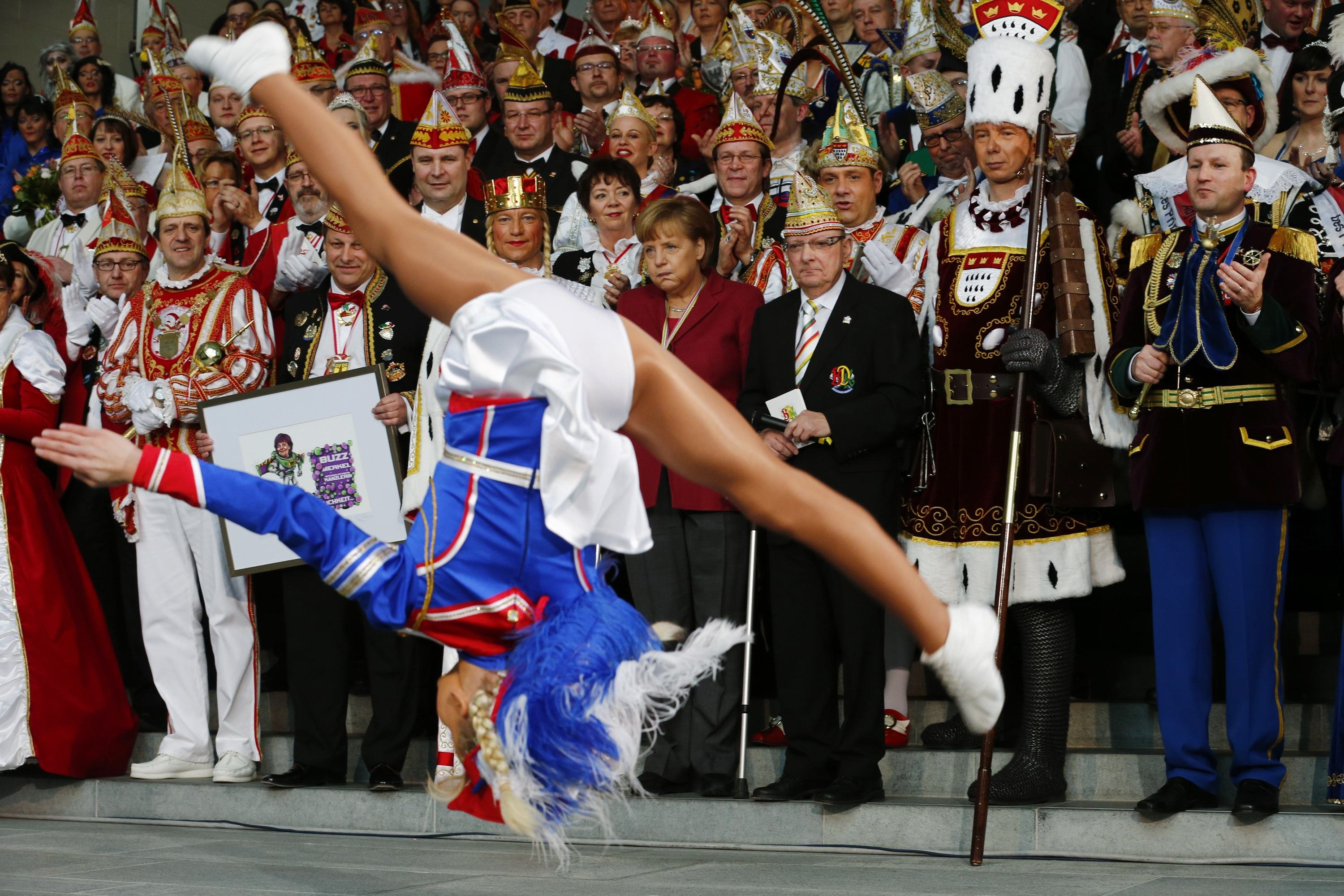 German Chancellor Angela Merkel (C) watches a dance performance by Liana Wolf during a reception of German carnival societies at the Chancellery in Berlin Feb. 18, 2014.