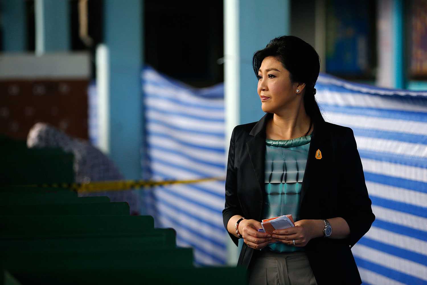 Thai Prime Minister Yingluck Shinawatra holds her ballot before casting it at a polling station in Bangkok Feb. 2, 2014