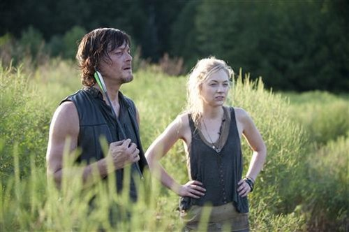 Daryl Dixon (Norman Reedus) and Beth Greene (Emily Kinney) in AMC's The Walking Dead.