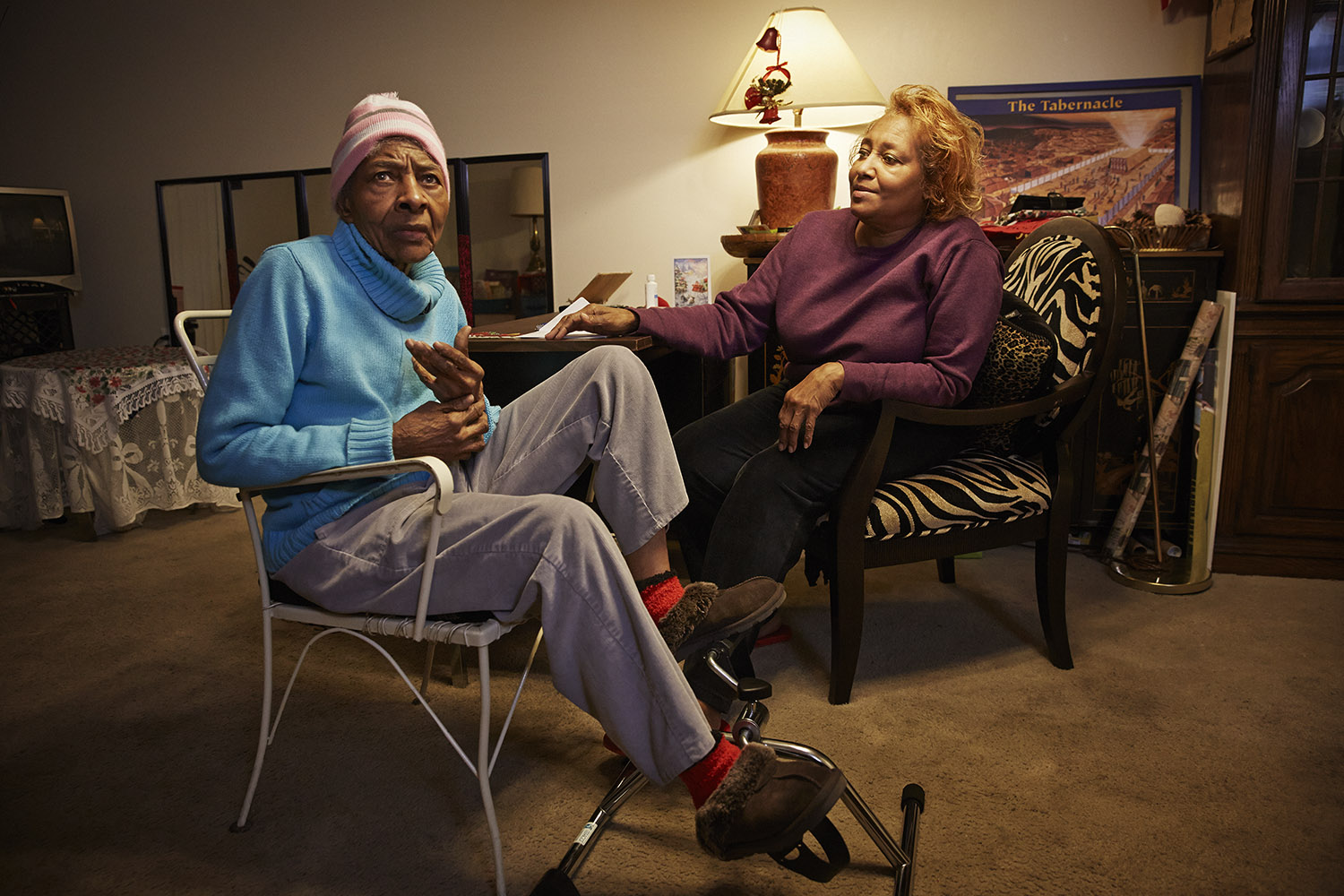 J.B. Hillman Rushell, right, at home in subsidized senior housing with her elderly mother who needs around-the-clock care for dementia, Detroit, Mich. Before the cut, she was receiving $18/month. She now receives $16/month.