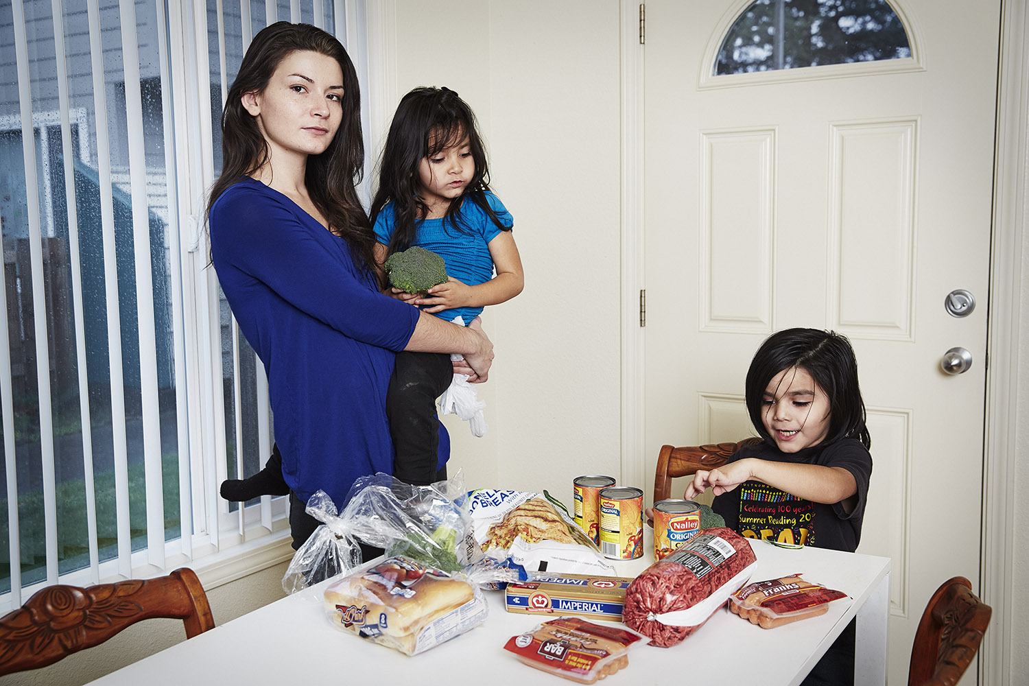 Jennifer Noonan at home with her two children, Portland, Ore. Before the cut, she was receiving $524/month in SNAP benefits. Now she receives $475/month.