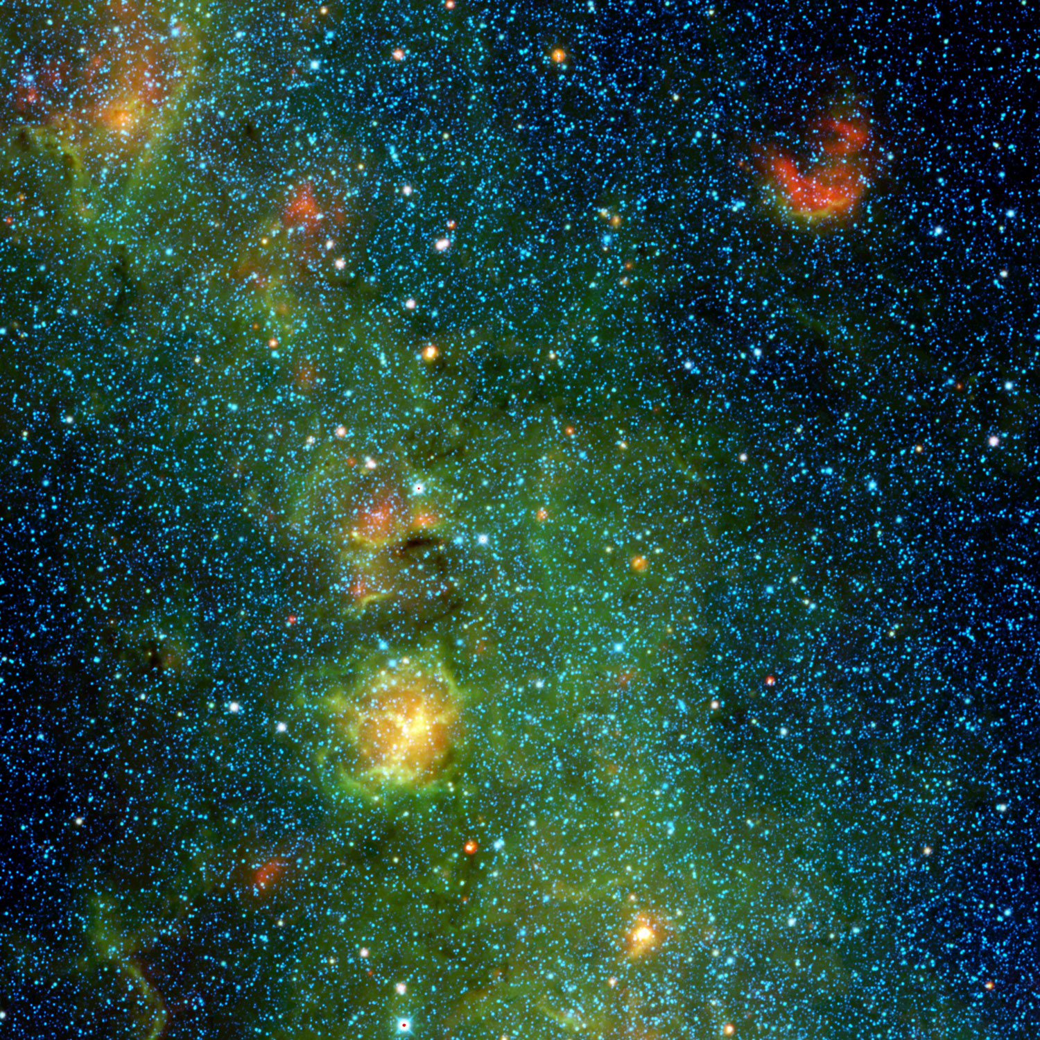 A storm of stars is brewing in the Trifid nebula, in this view from NASA's Wide-field Infrared Survey Explorer, or WISE, released on Jan. 29, 2014. The stellar nursery, where baby stars are bursting into being, is the yellow-and-orange object dominating the picture.