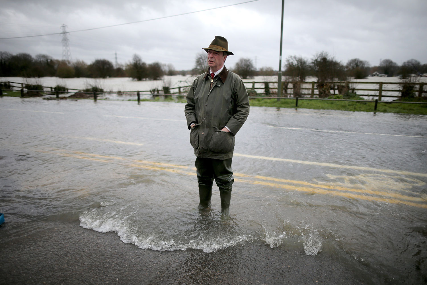 Leader of UKIP Nigel Farage tours flooded properties  and roads as he visits Chertsey on Feb. 11, 2014 in Chertsey, United Kingdom.