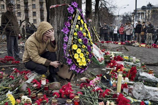 A woman mourns at a memorial for protesters killed in Kiev's recent violence.