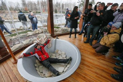A protester poses in a bathtub at President Viktor Yanukovych's Mezhyhirya estate, which was abandoned by security, on Feb. 22, 2014 in Kiev, Ukraine.