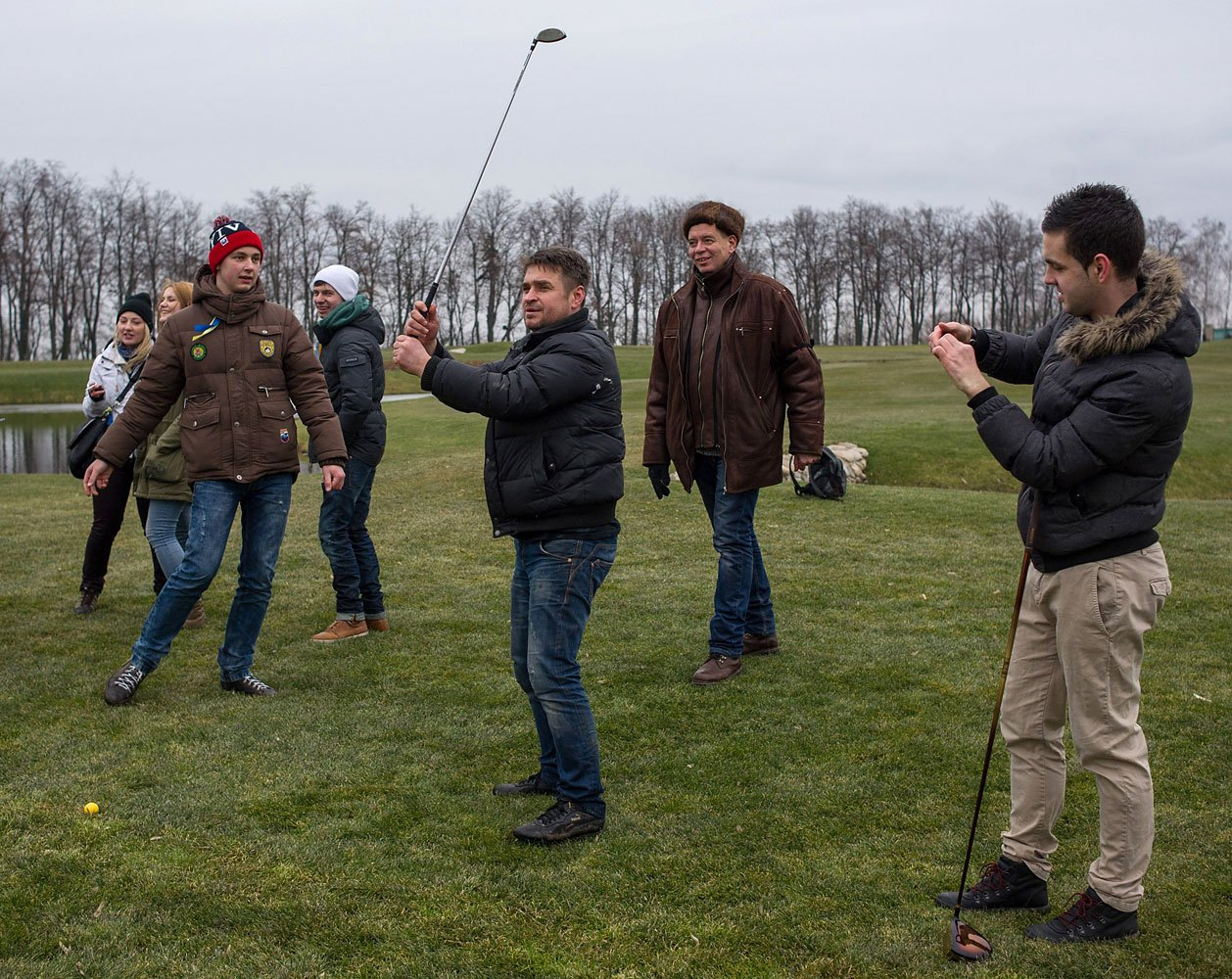 Protesters try to play on a golf course at the Ukrainian President Yanukovych's countryside residence.