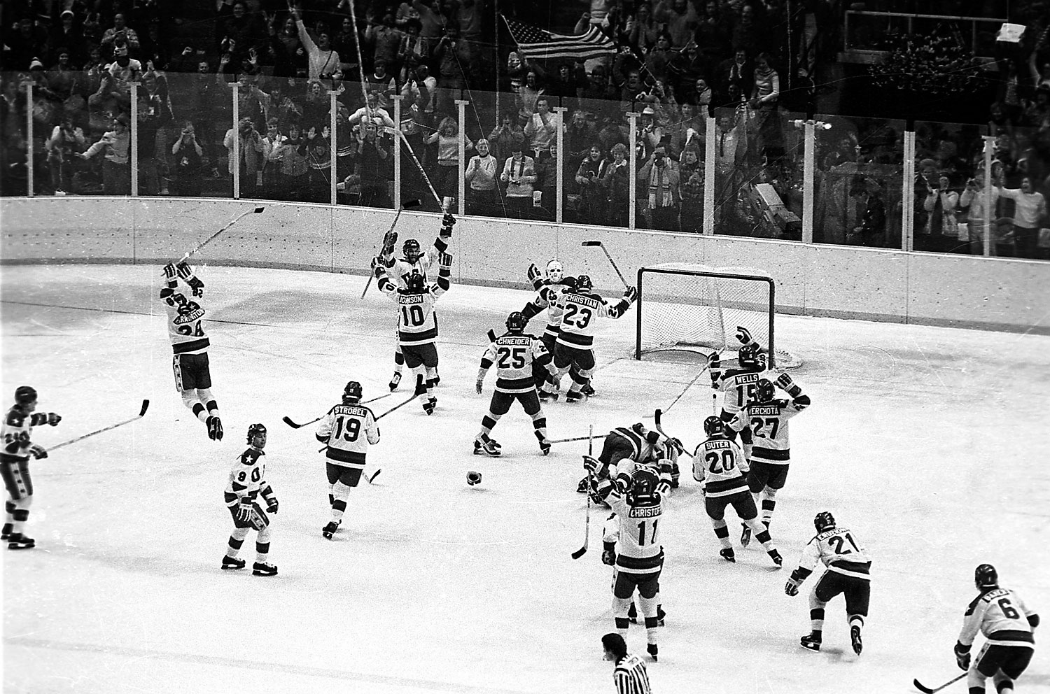 The U.S ice hockey team rushes toward goalie Jim Craig after their upset win over the Soviet Union in the semi-final round of the XIII Winter Olympic Games in Lake Placid, N.Y., Feb. 22, 1980.