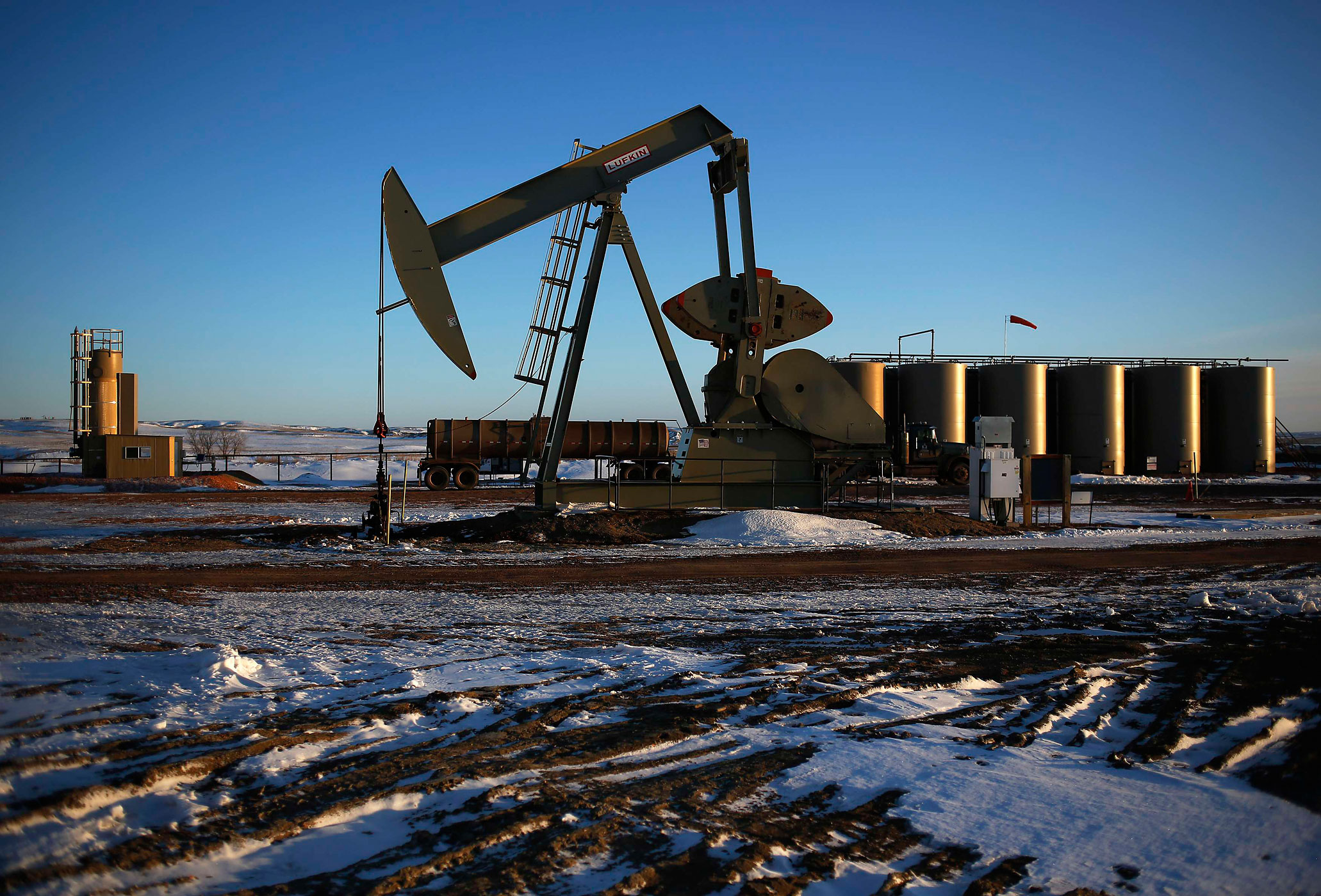 An oil drilling pump site is seen in McKenzie County outside of Williston, N.D., March 12, 2013.
