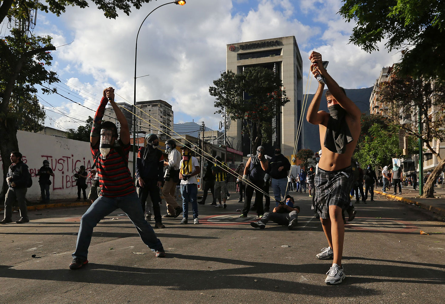 Demonstrators use a giant slingshot to launch stones at Bolivarian National Guards during clashes in Caracas, March 2, 2014.