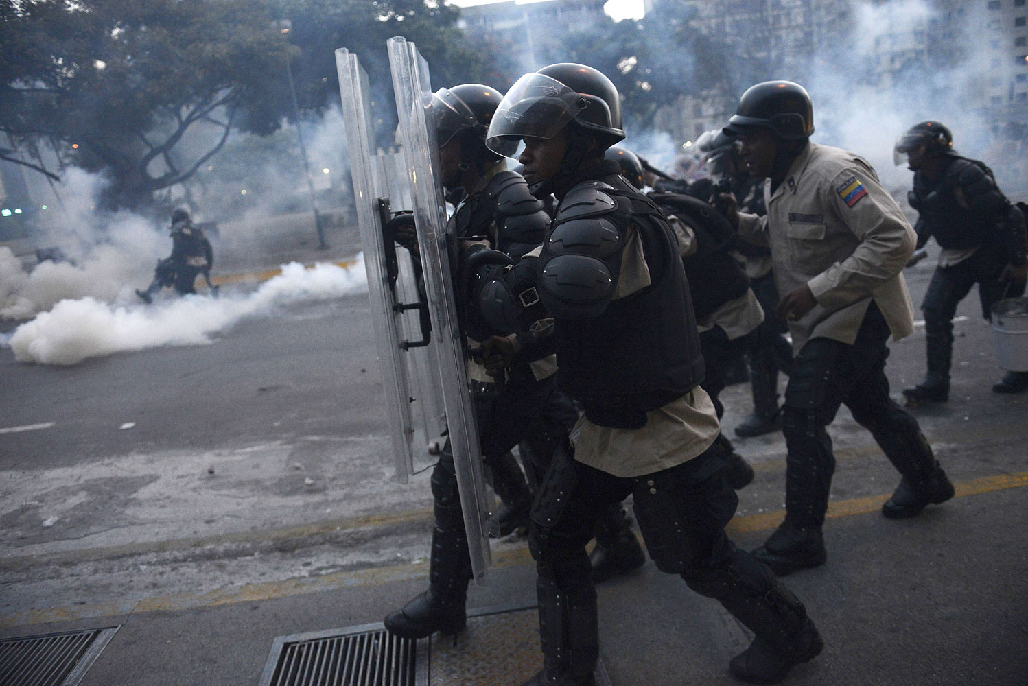 Riot police clash with opponents of Venezuelan President Nicolas Maduro during an anti-government protest in Caracas on Feb. 27, 2014.