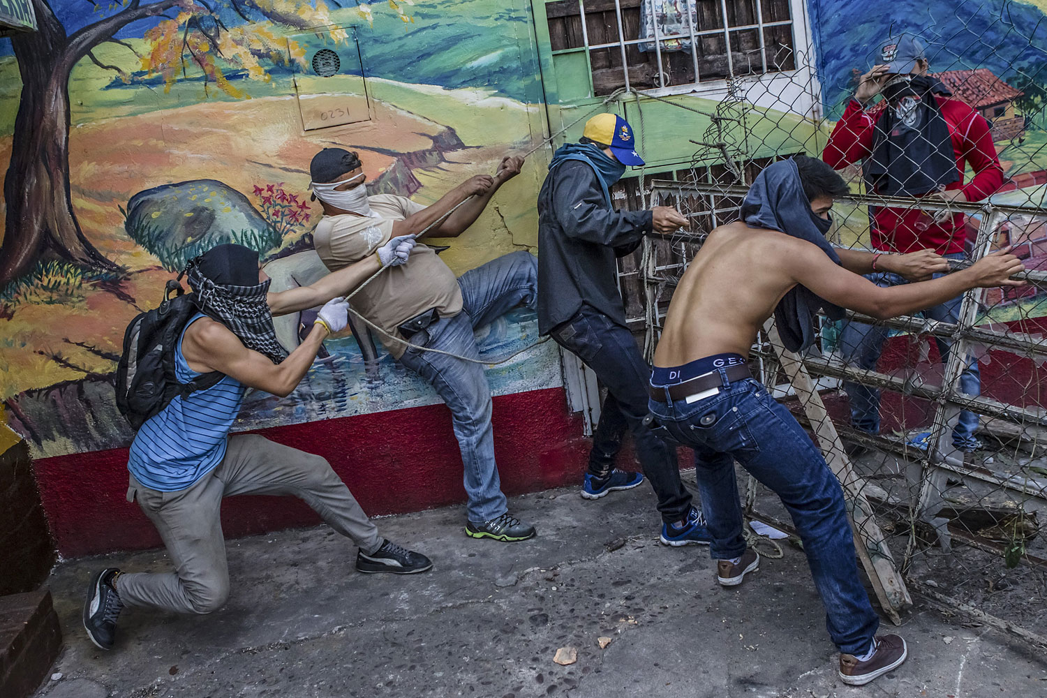 Protesters build a barrier in the Las Pilas area of San Cristobal, Feb. 24, 2014. The capital of Tachira State, bordering Colombia, is the site of the some of the fiercest protests against the government of President Nicolas Maduro.