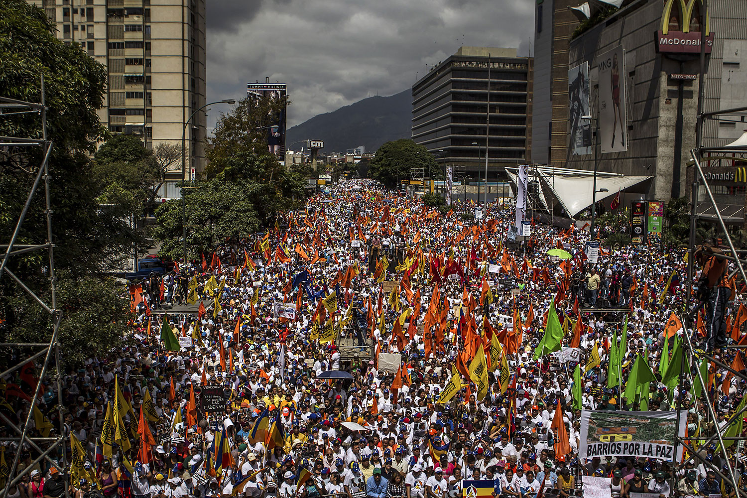 Supporters of the Venezuelan opposition rally on a street in Caracas, Feb. 22, 2014.